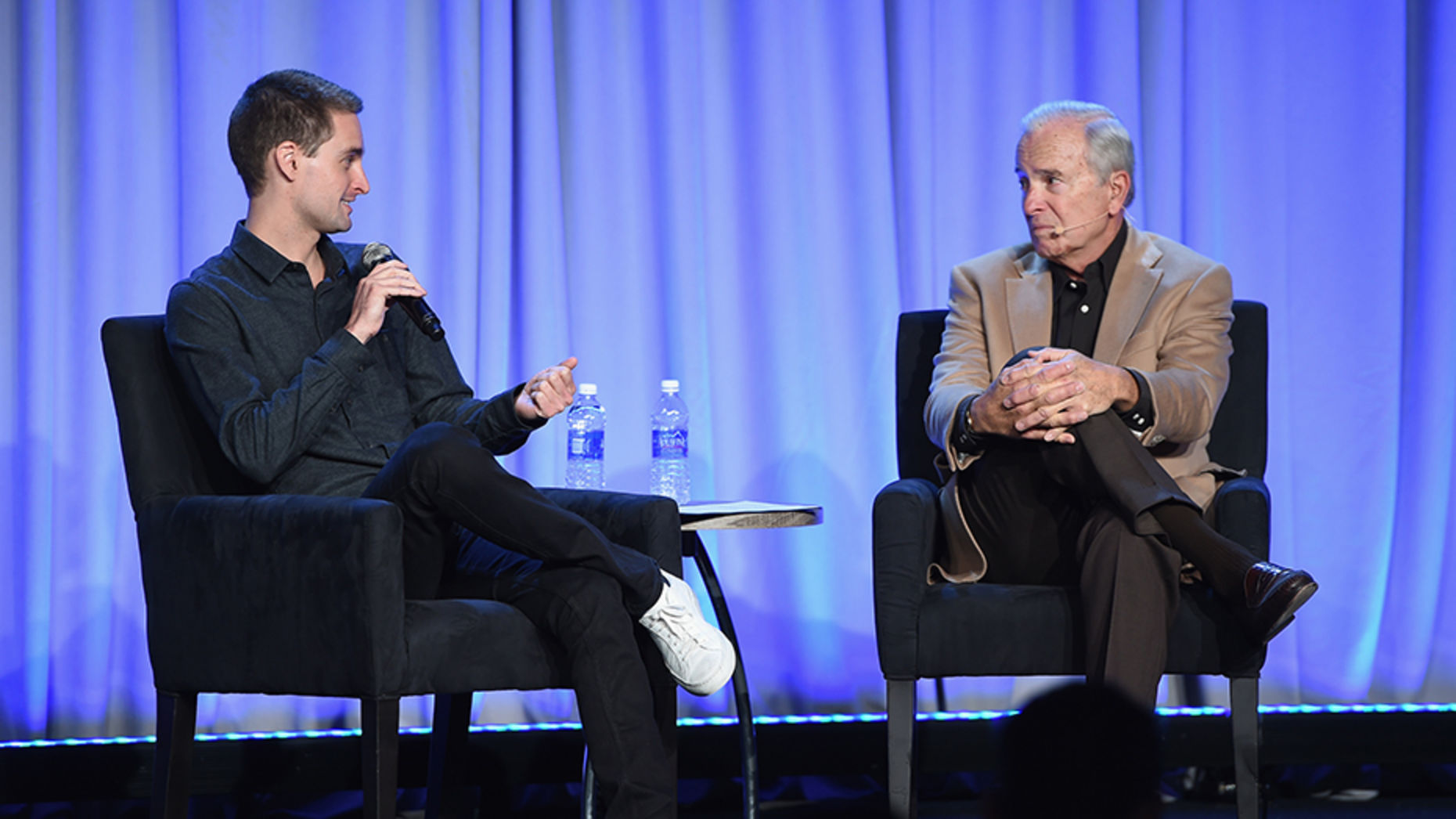 Snapchat CEO Evan Spiegel speaks to journalist Ken Auletta. Photo by Larry Busacca/Getty Image.