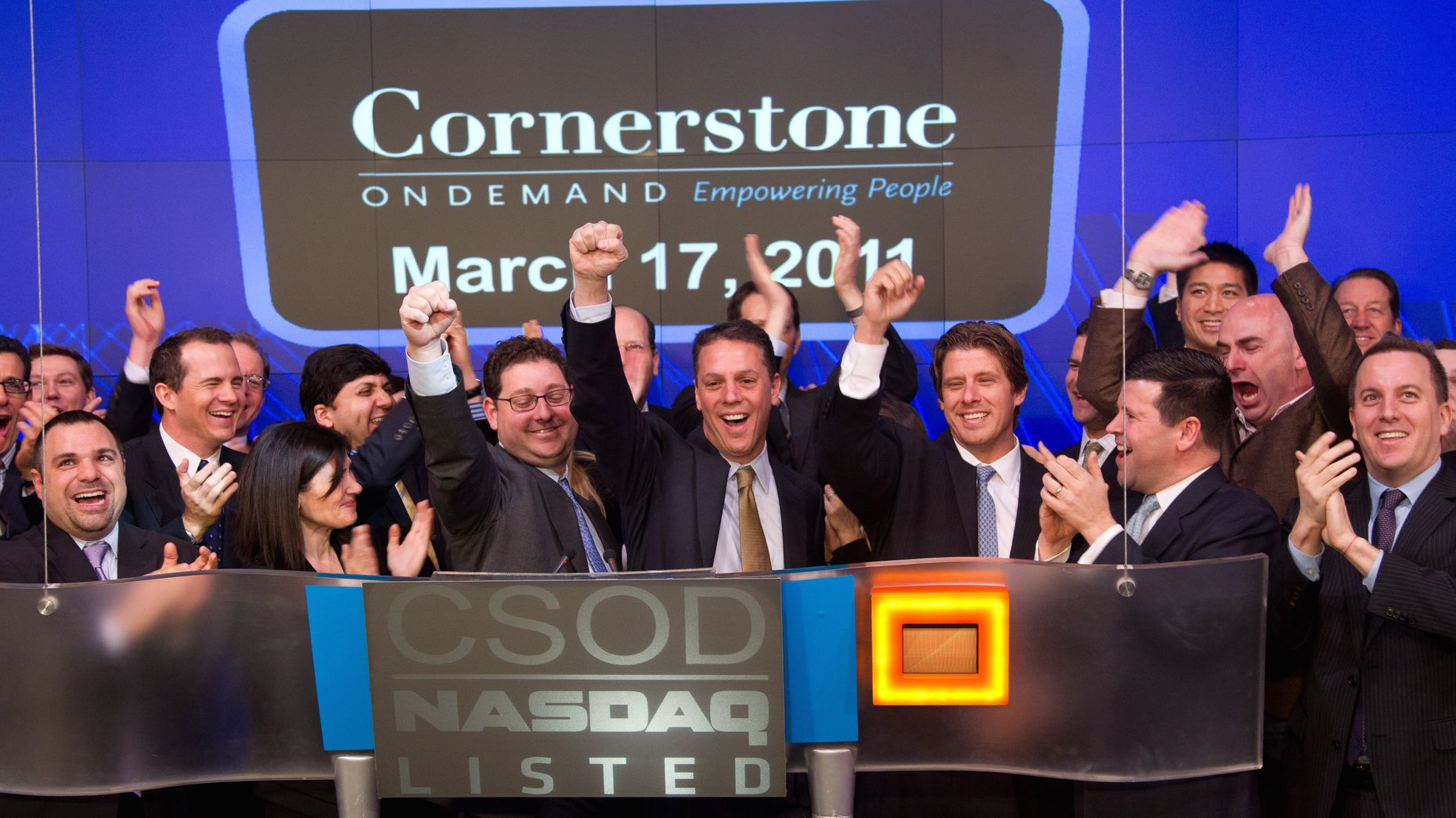 Cornerstone executives, including CEO Adam Miller in the center, on the day the company listed on Nasdaq. Photo by Nasdaq.