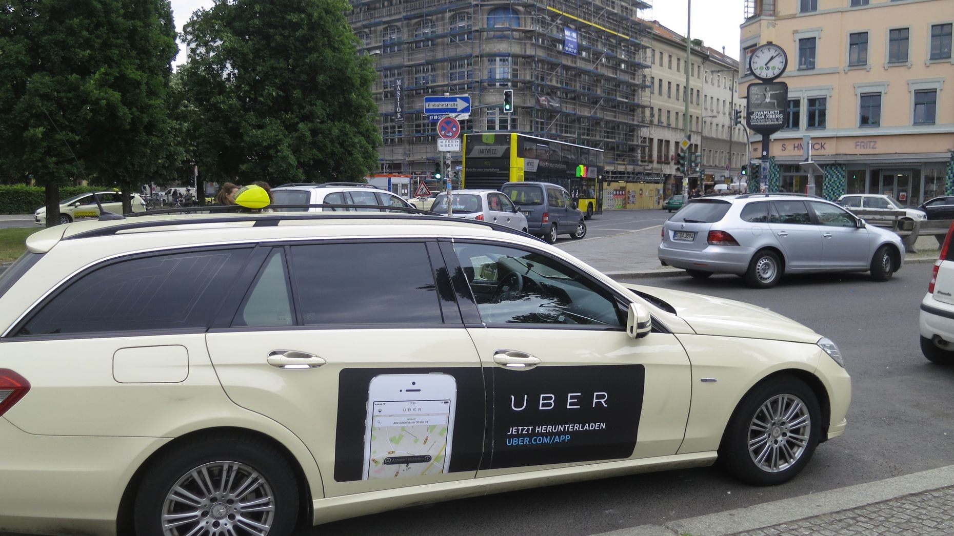 An Uber ad on a taxi. Photo by Flickr/Alper Cugun.
