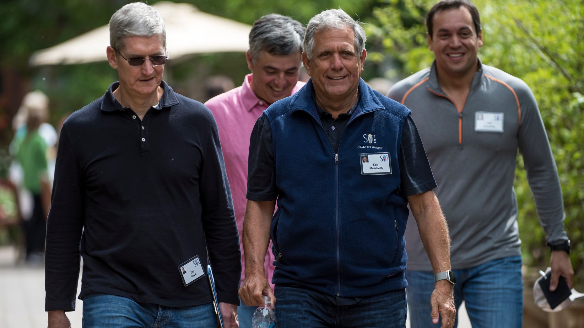 Tim Cook, left, Eddy Cue, Les Moonves and Joe Ianniello of CBS. Photo by Bloomberg.
