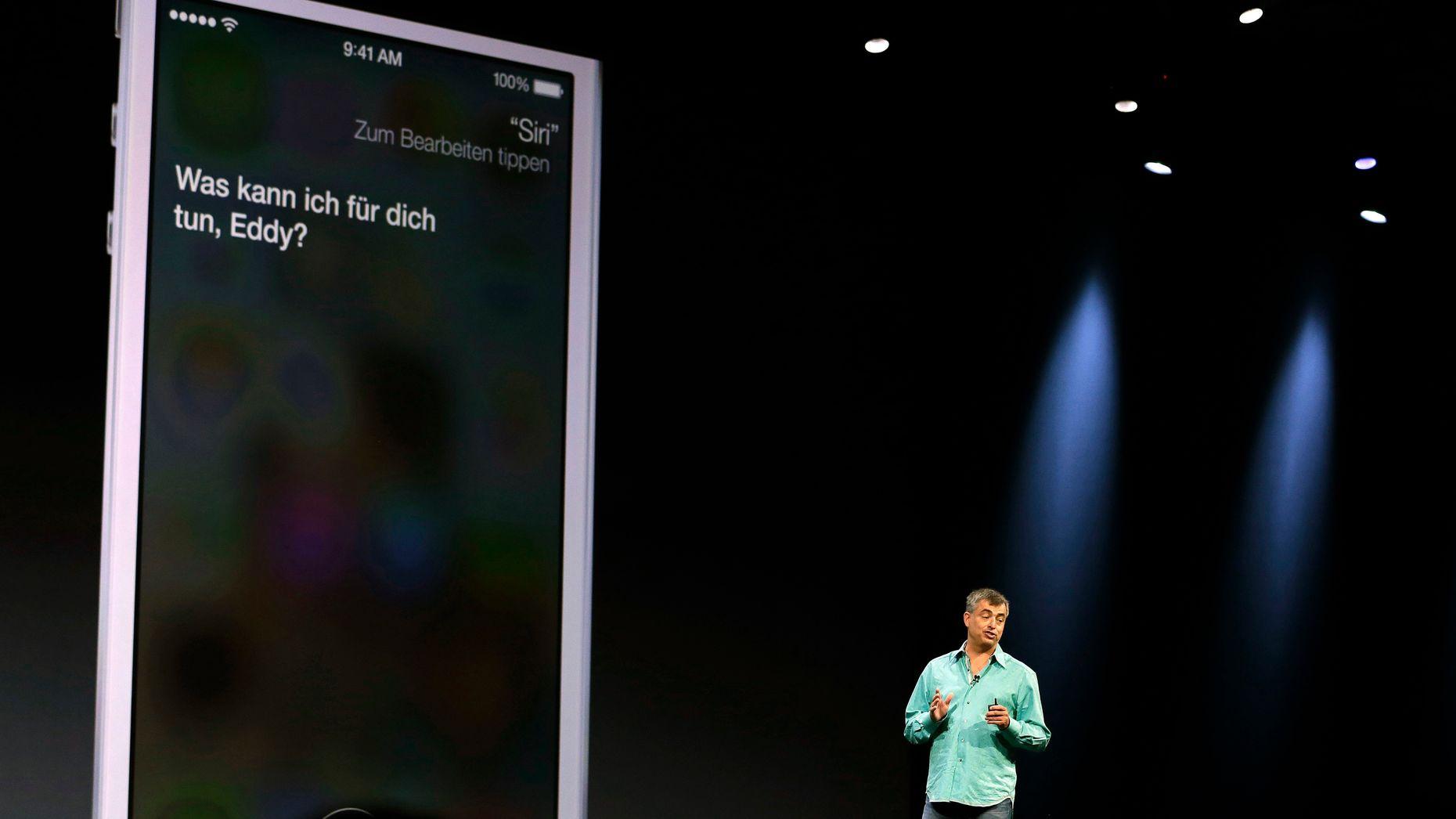 Eddy Cue showing off Siri in 2013. Photo by AP.