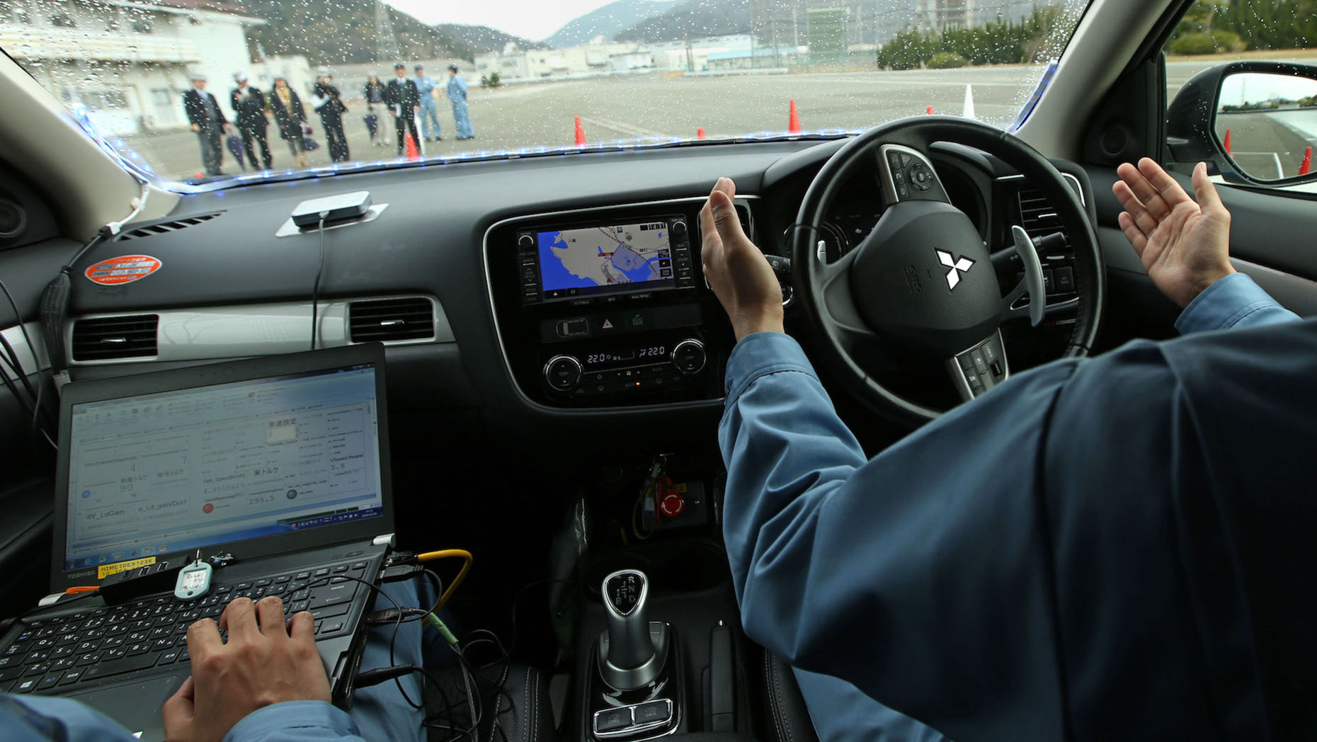 A self-driving Mitsubishi car. Photo by Bloomberg.