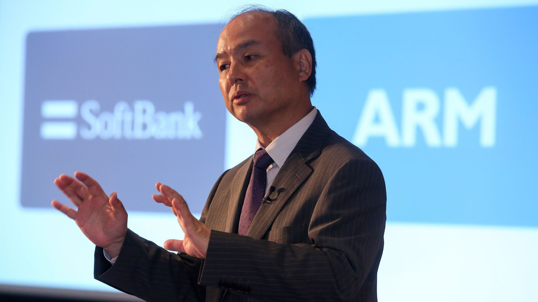 SoftBank Group Chairman Masayoshi Son announcing SoftBank's purchase of ARM Holdings this month. Photo by Bloomberg.