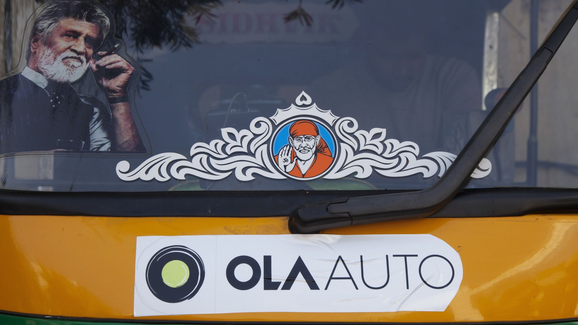 Promotional stickers for Ola on an auto rickshaw in Bangalore. Photo by Bloomberg.