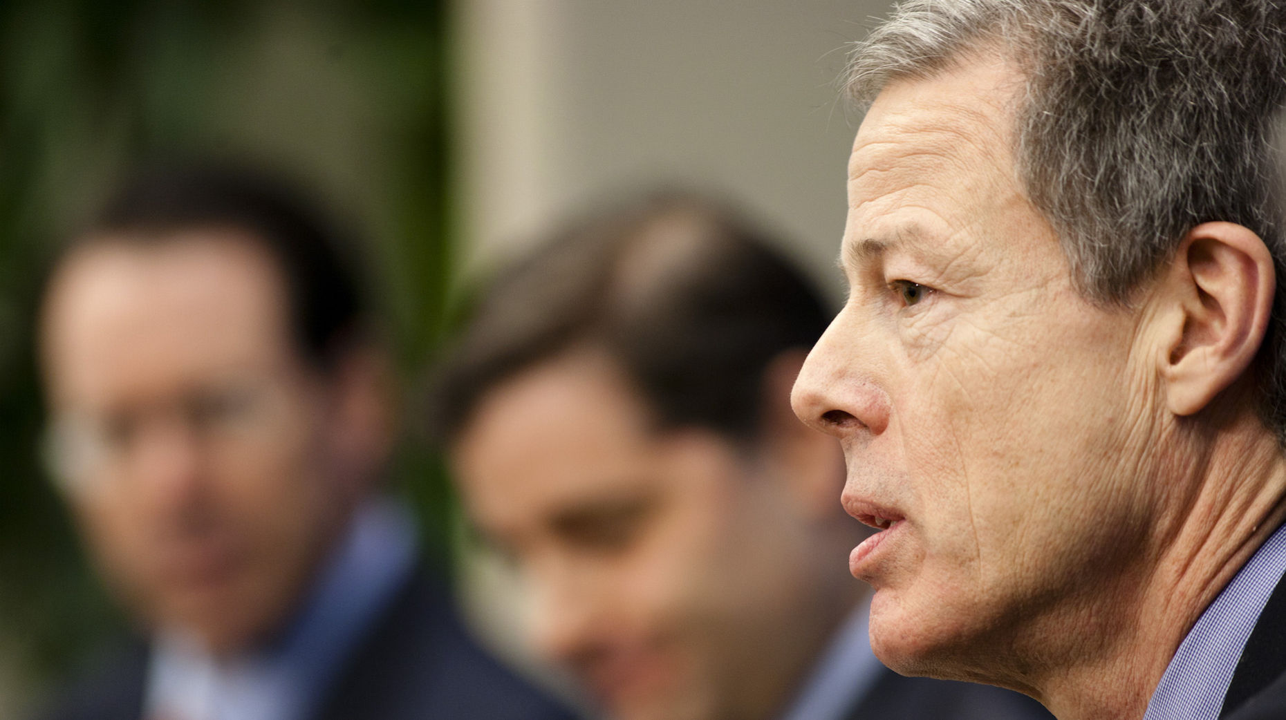 Time Warner CEO Jeff Bewkes with AT&T CEO Randall Stephenson in the background. Photo by Bloomberg.