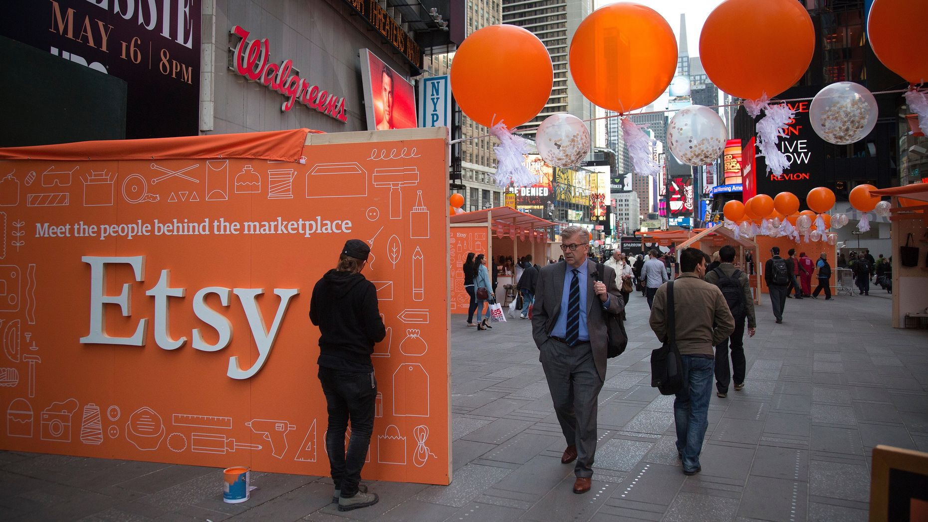 Merchants who use Etsy display their wares outside the Nasdaq MarketSite in New York the day Etsy went public last year. Photo by Bloomberg.