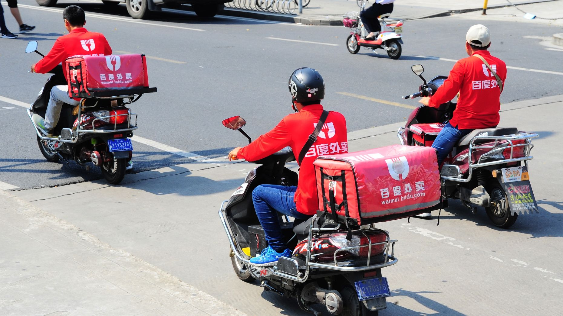 Couriers of Baidu Waimai on the road in Taicang city. Photo by AP.