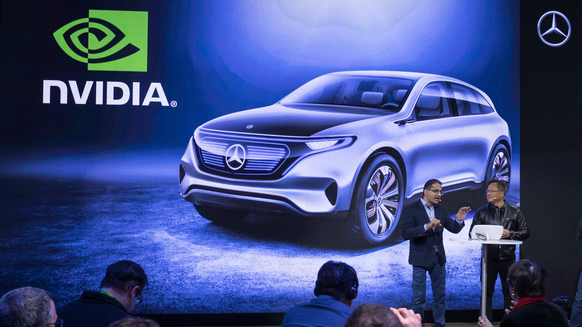 Nvidia CEO Jen-Hsun Huang (right) and Sajjad Khan, VP of digital vehicle at Mercedes, announce the companies' partnership during CES. Photo by Daimler.