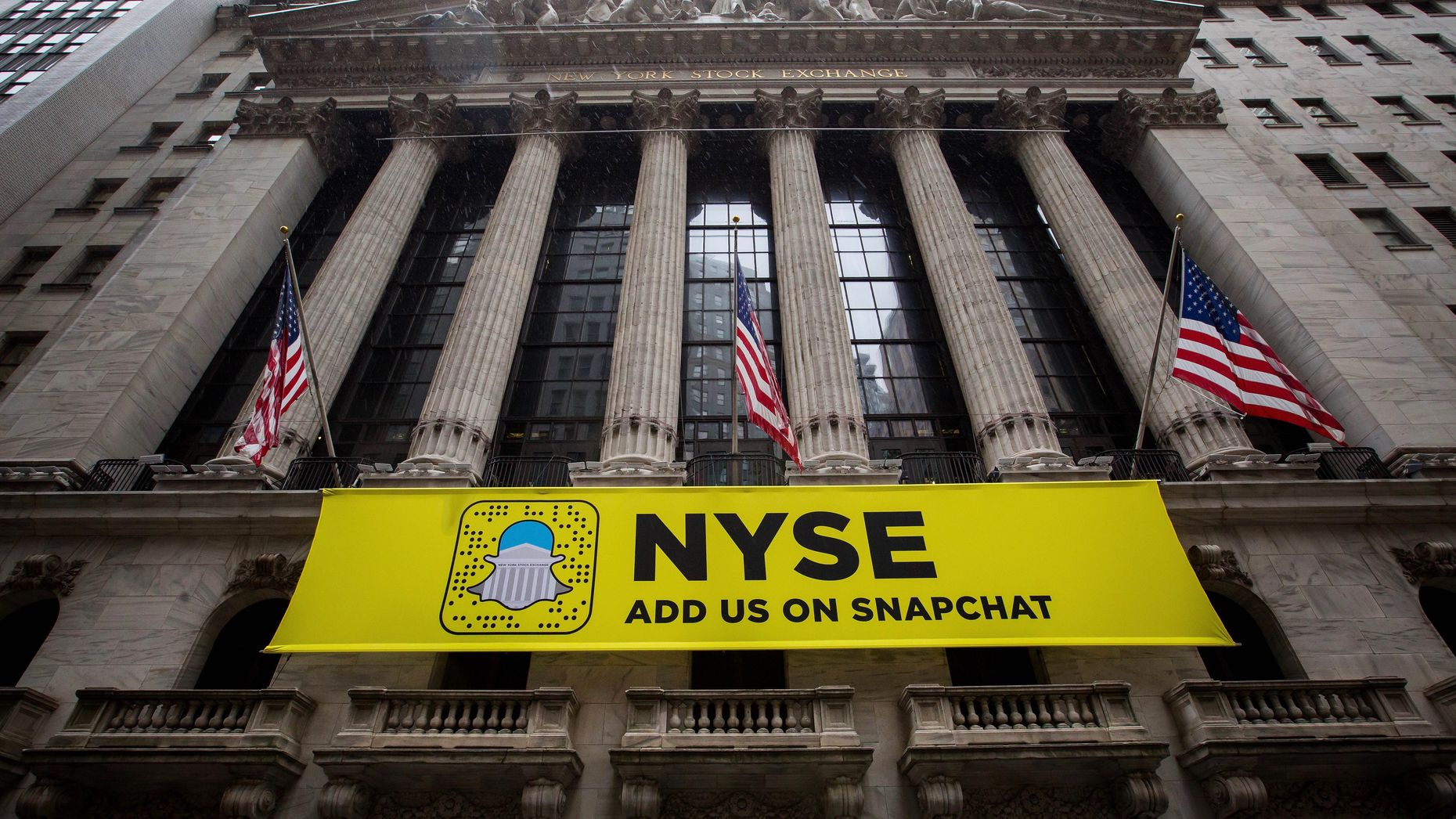 A Snap banner at the New York Stock Exchange. Photo by Bloomberg.