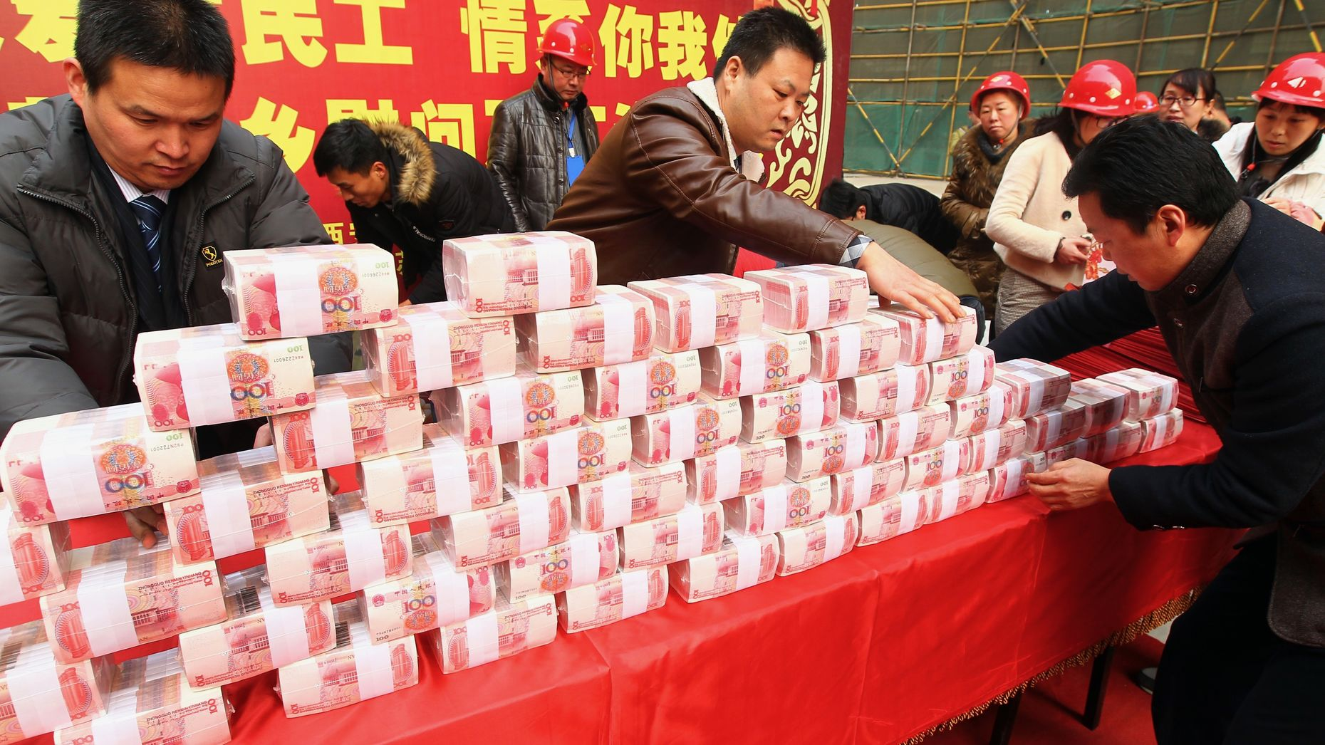Stacks of Chinese RMB currency to be handed out to workers at a real estate project in China last month. Photo by AP.
