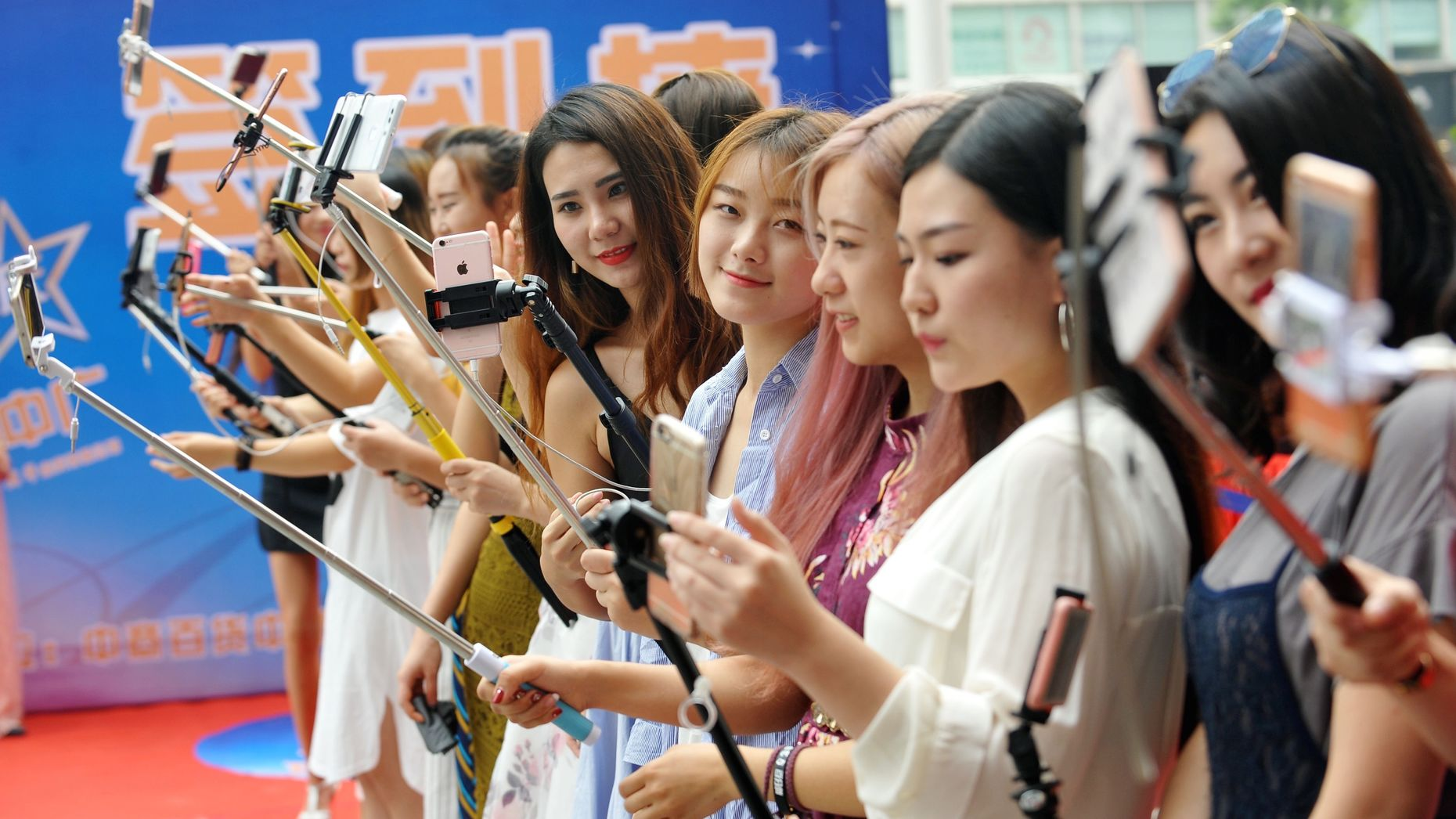 A group of women live streaming at a shopping mall in China last September. Photo by AP.