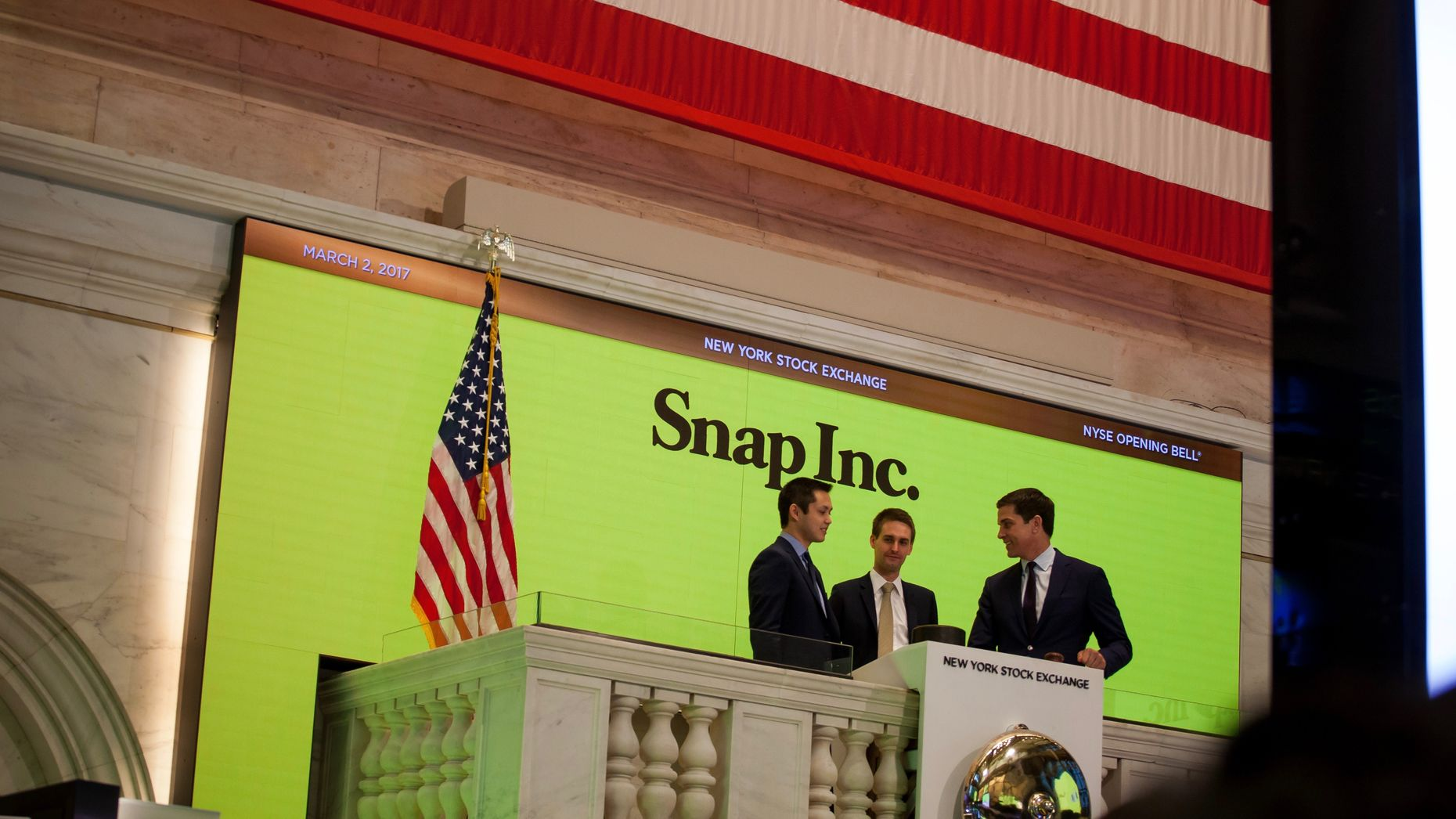 Snap co-founders Robert Murphy and Evan Spiegel at the New York Stock Exchange on Snap's IPO day, with NYSE President Tom Farley. Photo by Bloomberg.