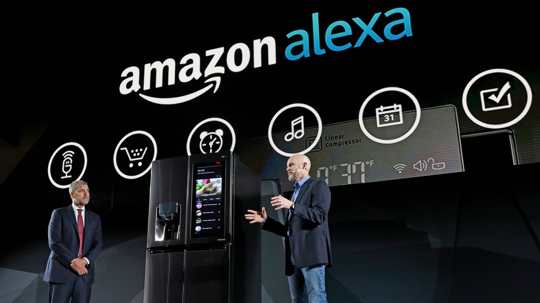 LG Electronics' vice president David VanderWaal and Amazon Echo vice president Mike George unveiling an LG fridge equipped with Amazon Alexa at CES in January. Photo by AP