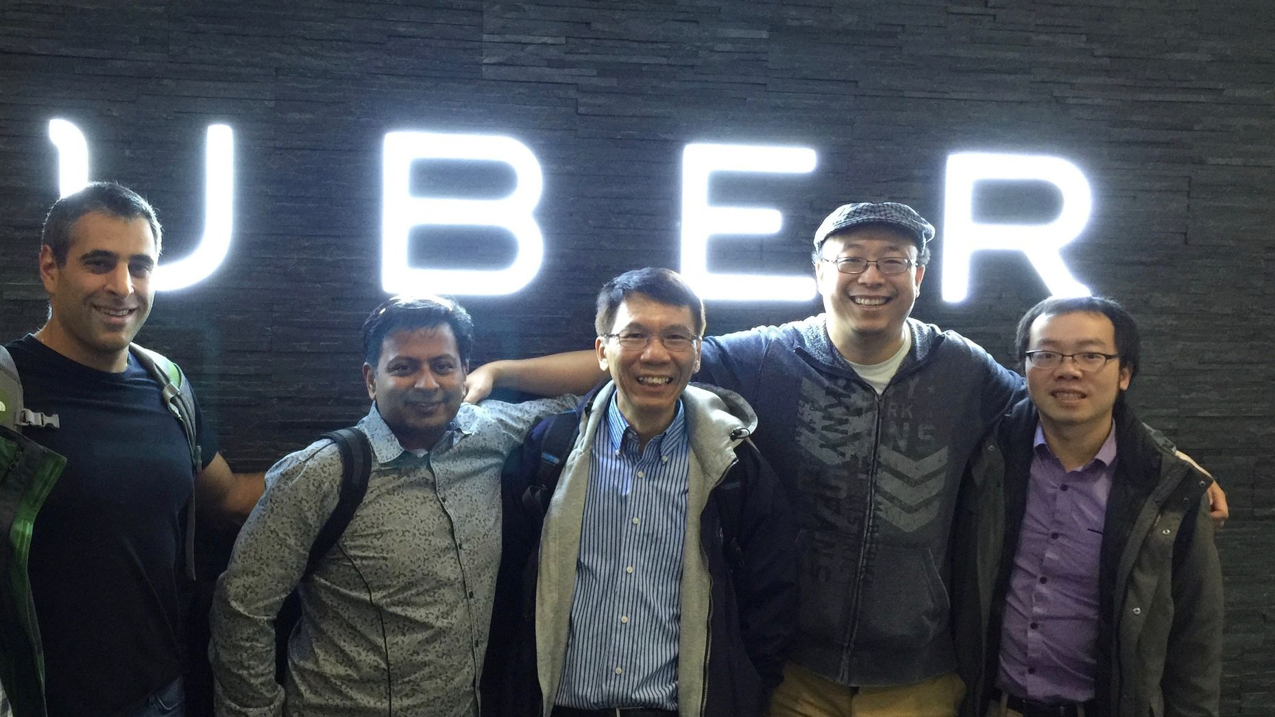 Uber's Chief Technology Officer Thuan Pham, center, with fellow engineers.