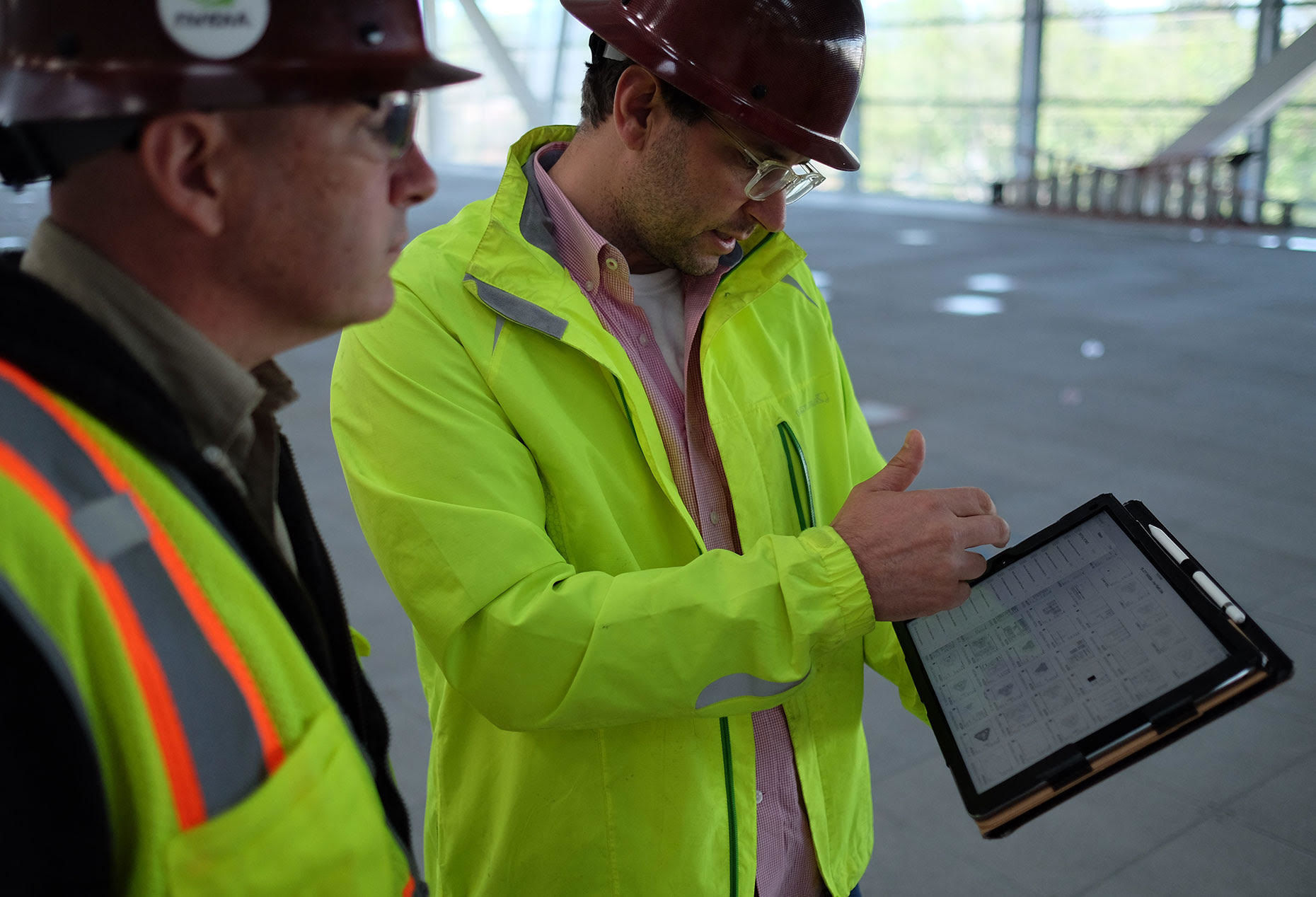 A Nvidia employee uses PlanGrid on the construction site for the chipmaker's new headquarters in Santa Clara, Calif.