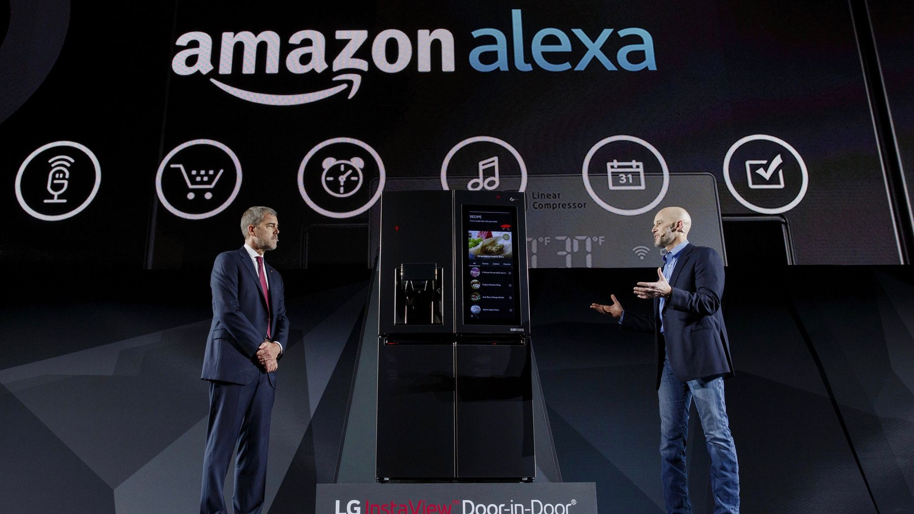David VanderWaal, vice president of marketing for LG Electronics USA and Michael George, vice president of Alexa, Echo, and Appstore at Amazon, discussing an LG-Amazon Alex partnership at CES this year. Photo by Bloomberg.