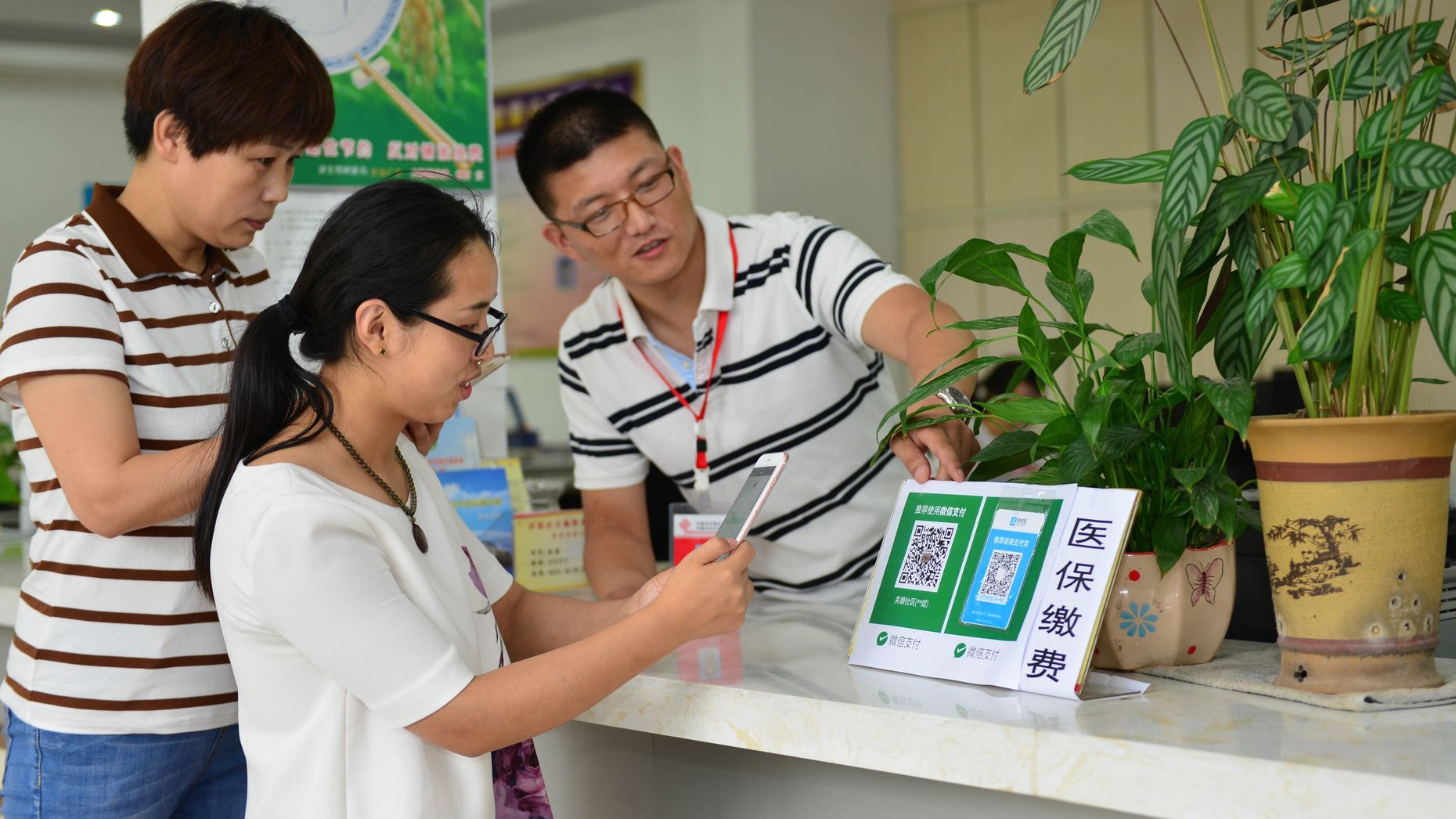 Chinese patients scanning a QR code to pay their medical bills using WeChat in June. Photo by AP.