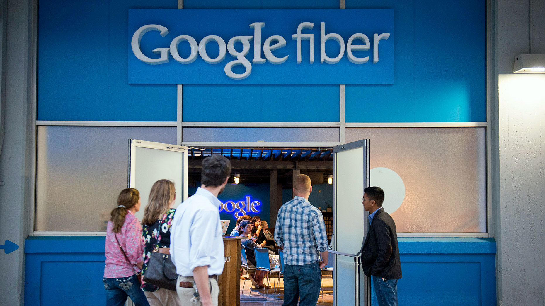 People walk past Google Fiber's store in Austin, Texas in April, 2015. Photo by Bloomberg.