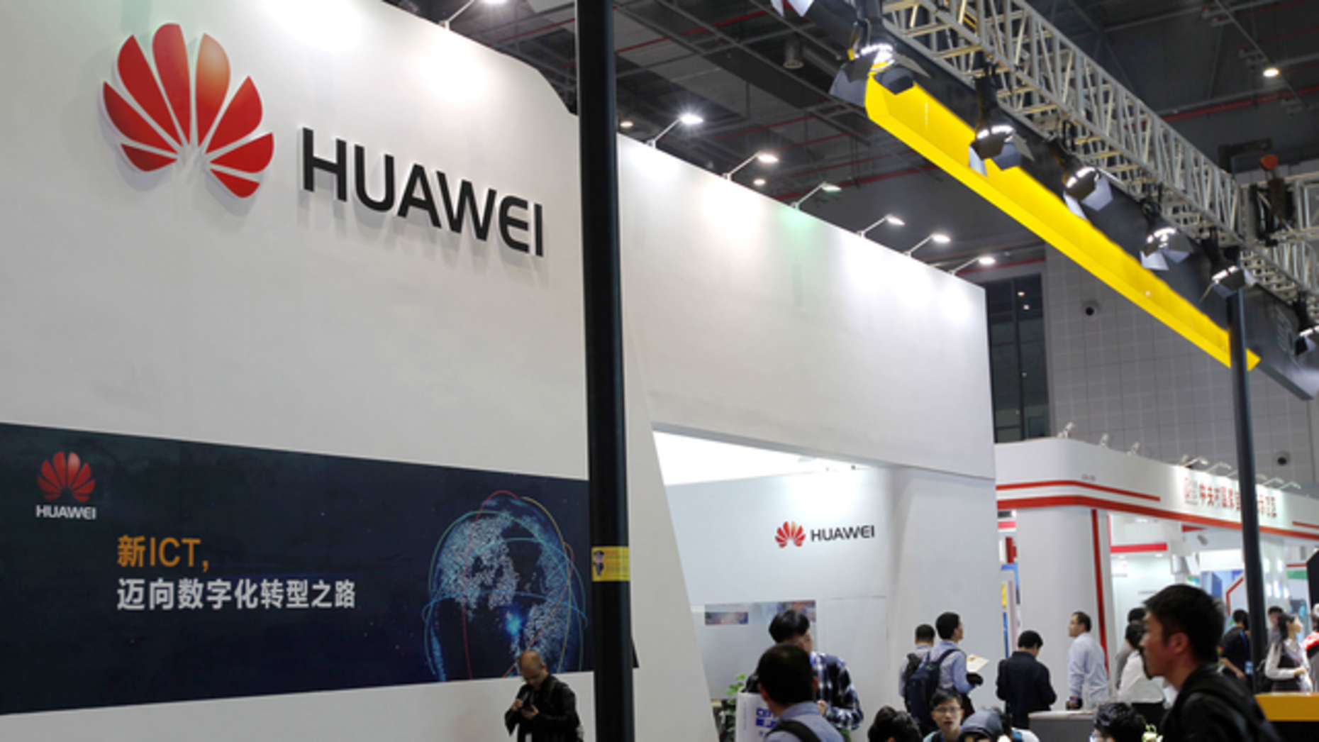 People visit Huawei's stand during an exhibition in Shanghai in late November.  Photo by AP