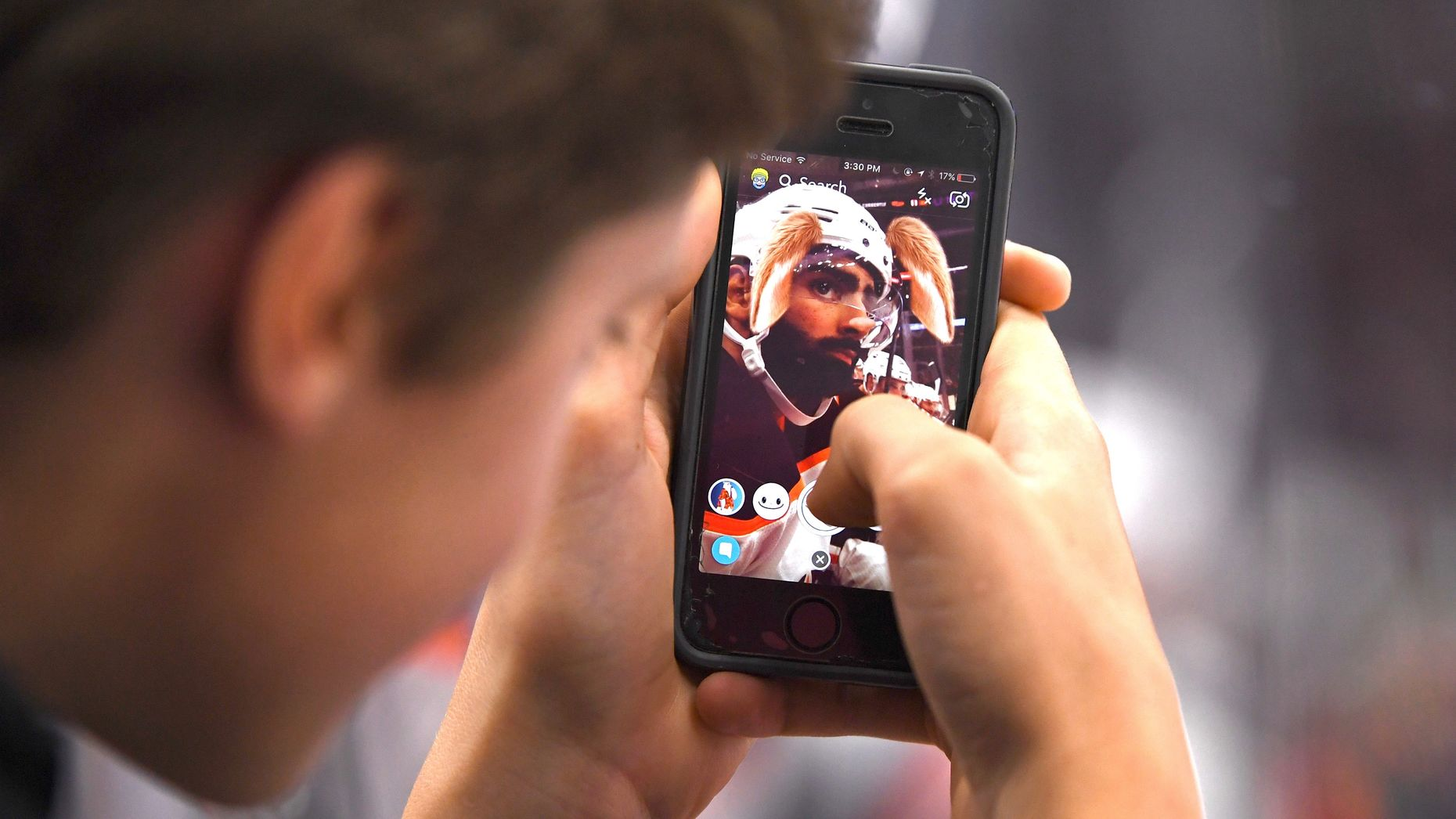 A Snapchat user putting a filter on Edmonton Oilers left wing Jujhar Khaira during a game earlier this month. Photo by AP.