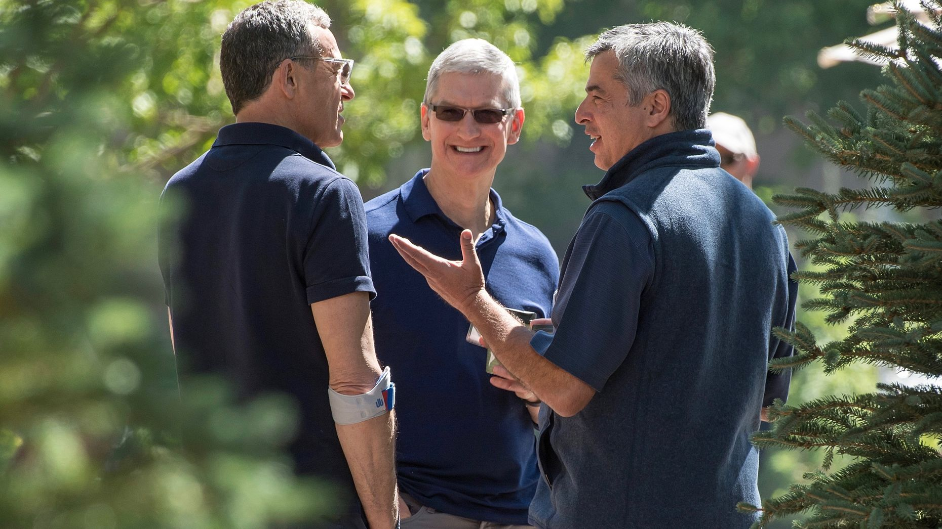 Disney CEO Robert Iger with Apple CEO Tim Cook and Apple executive Eddy Cue at Sun Valley in 2016. Photo by Bloomberg.