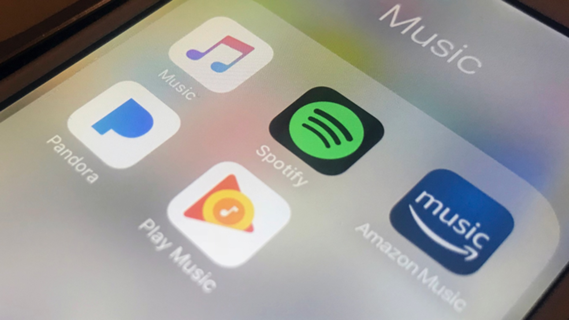 Music streaming apps shown on an iPhone. Photo: AP