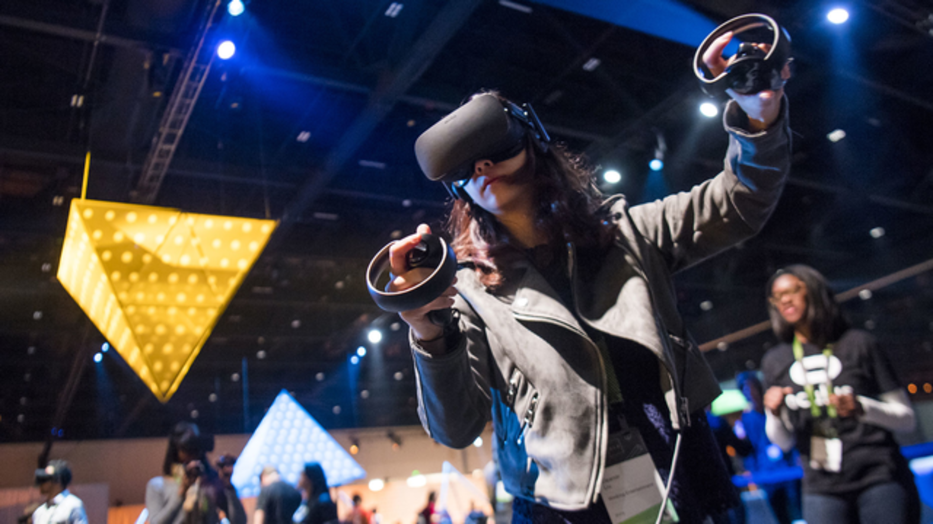 An attendee using the Oculus Rift VR headset at an event last October. Photo by Bloomberg.