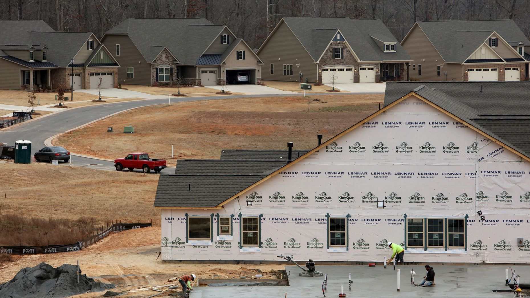 Contractors worked on a house under construction at the Lennar Tree Tops community development in Lancaster, S.C. Photo: Bloomberg