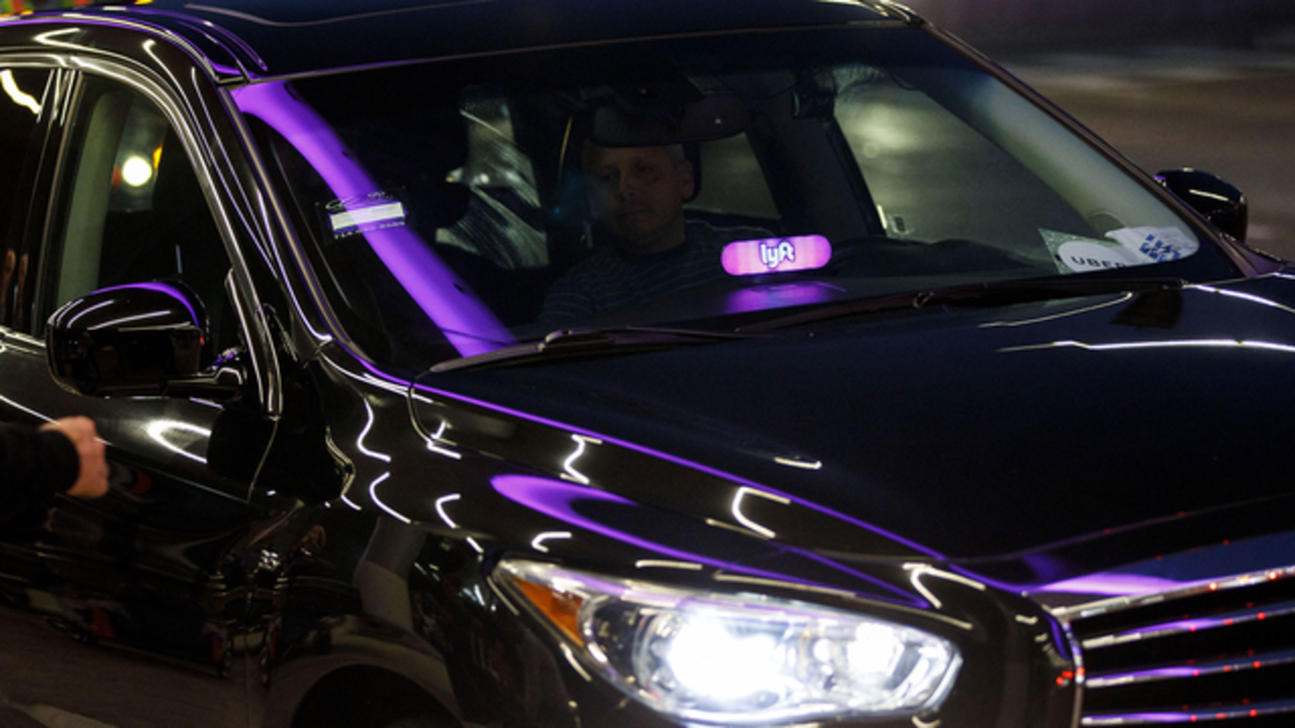 A Lyft car at Los Angeles airport. Photo by Bloomberg.