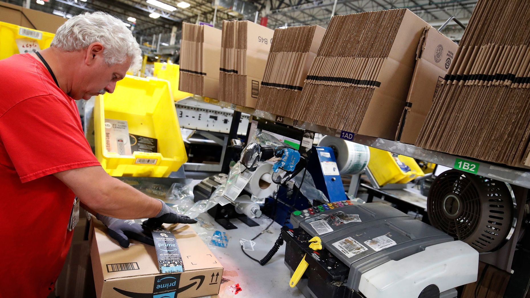A worker preparing an Amazon package for shipment, at Amazon's fulfillment center in Kenosha, Wisconsin. Photo by Bloomberg.