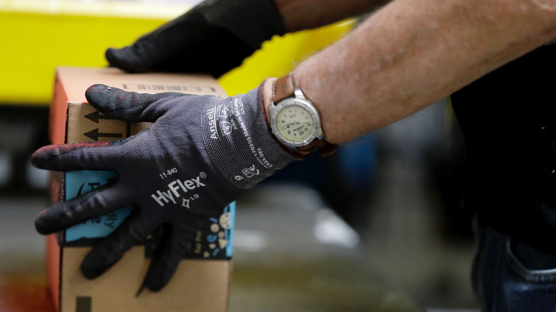 An employee packages a product at the Amazon Fulfillment center in Robbinsville Township, N.J. Photo: AP