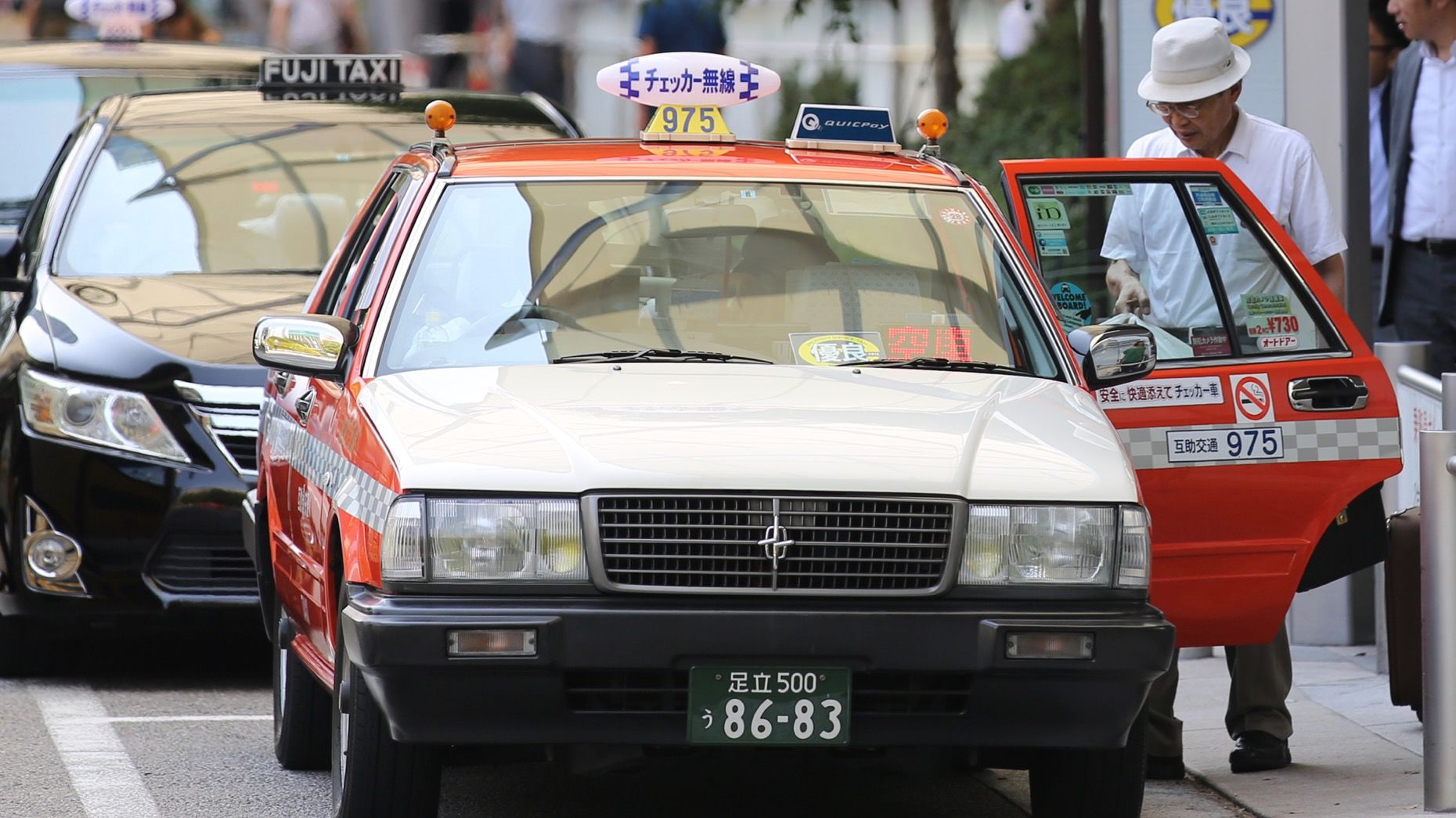 Taxis at a taxi stand outside a train station in Tokyo. Photo: Bloomberg