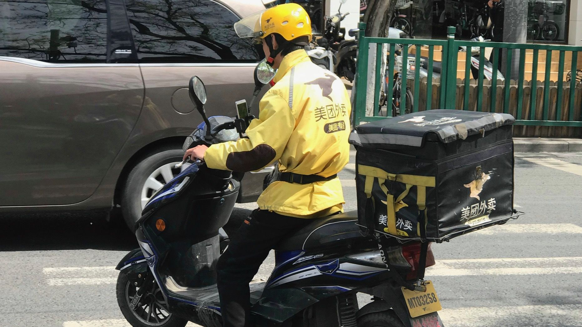 A Meituan food delivery courier in Beijing. Photo: AP