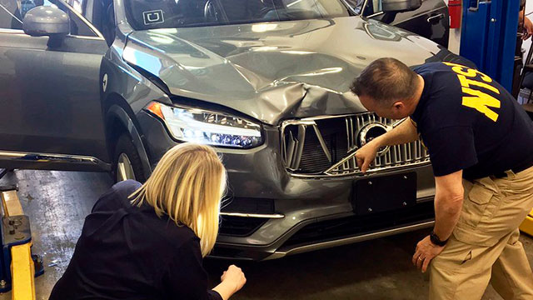 Investigators examined a self-driving Uber vehicle that fatally struck a woman in Tempe, Ariz., in March. Photo: AP