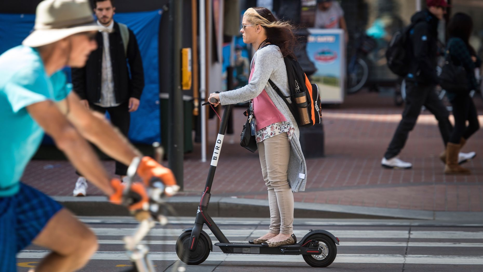 A woman riding a Bird scooter in San Francisco in April. Photo by Bloomberg.