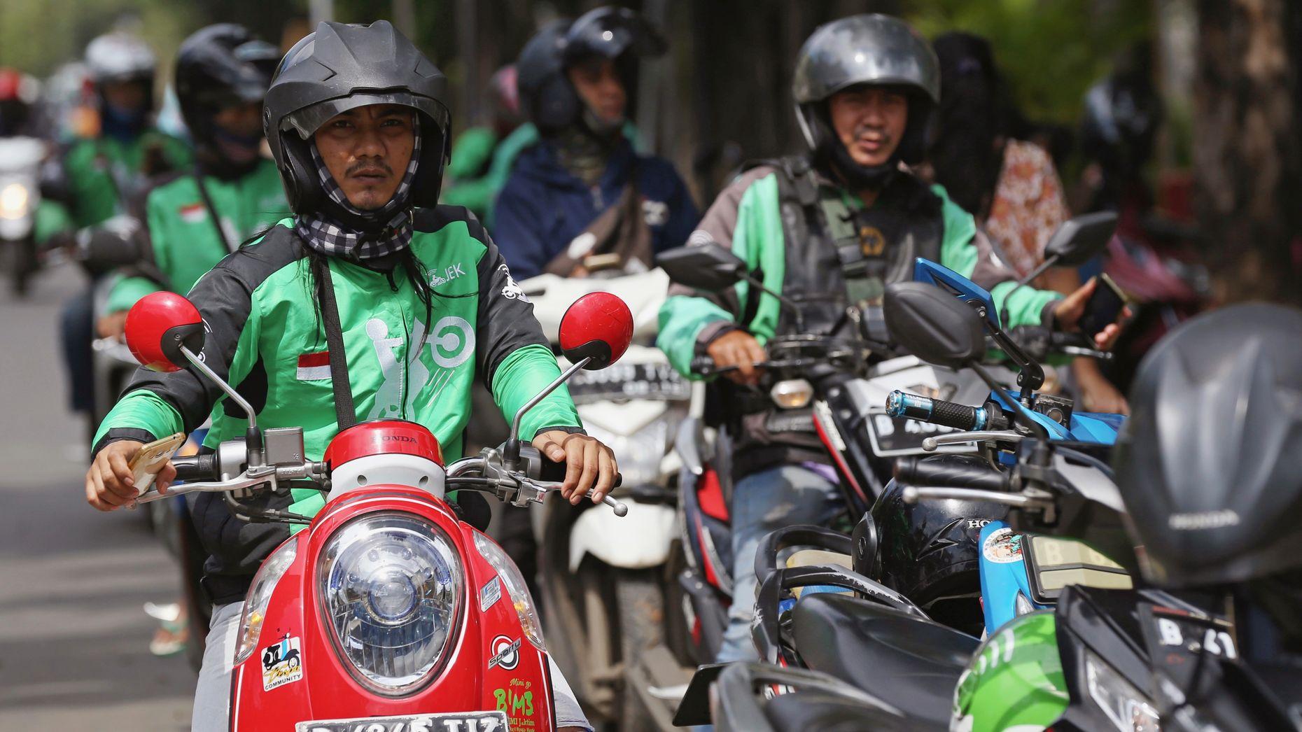 GoJek motorbike riders in Djakarta. Photo by AP