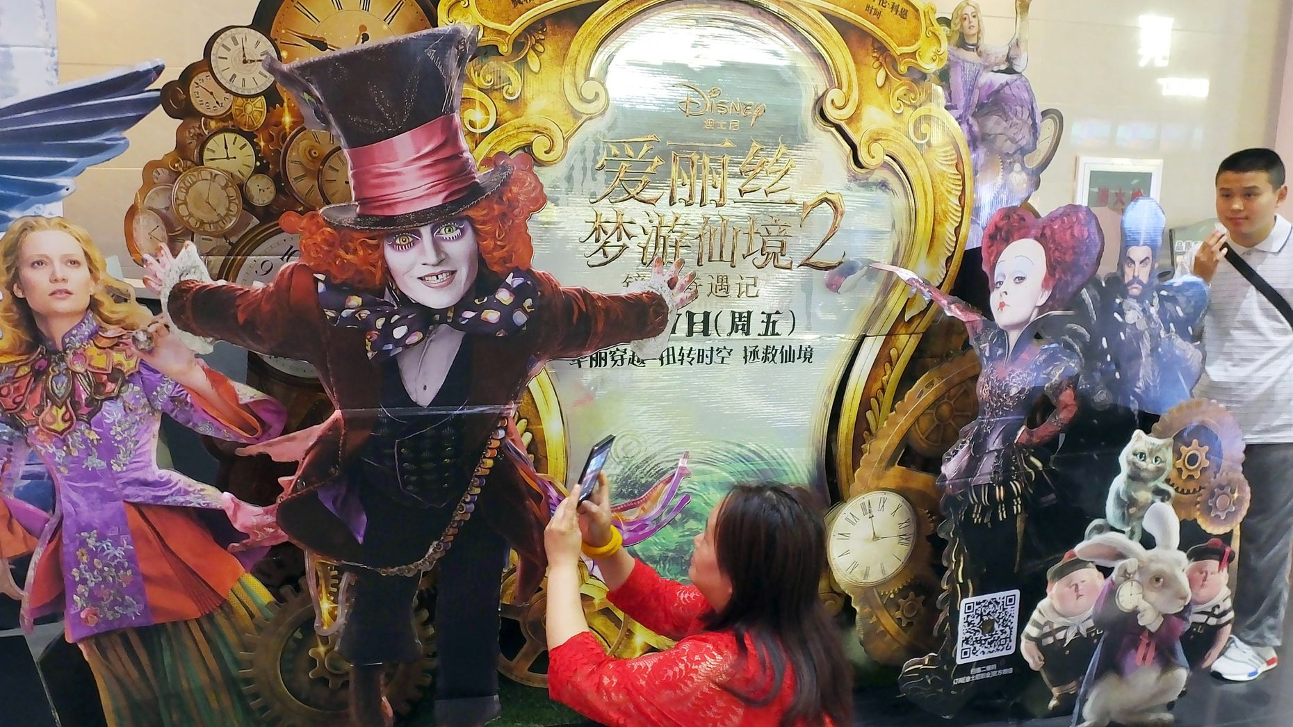 "A poster for the Disney movie ""Alice Through the Looking Glass"" at a movie theater in Yichang in China in 2016. Photo by AP."