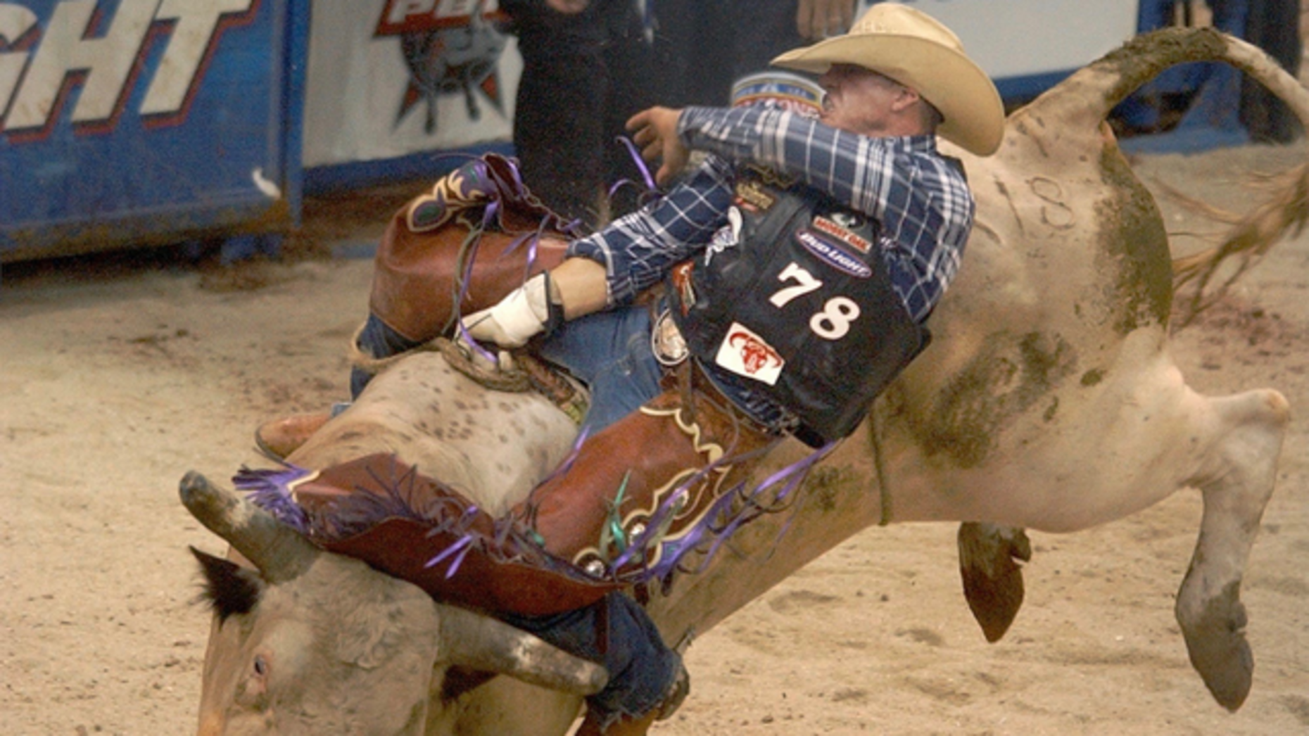 A bullrider during a Professional Bull Riders event. Endeavor now owns the Professional Bull Riders. Photo by AP.