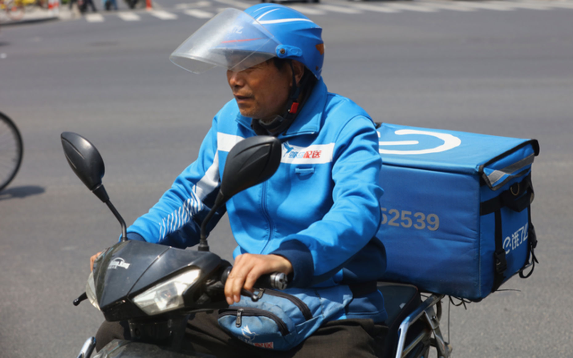 An Ele.me delivery courier in Shanghai in April. Photo by AP