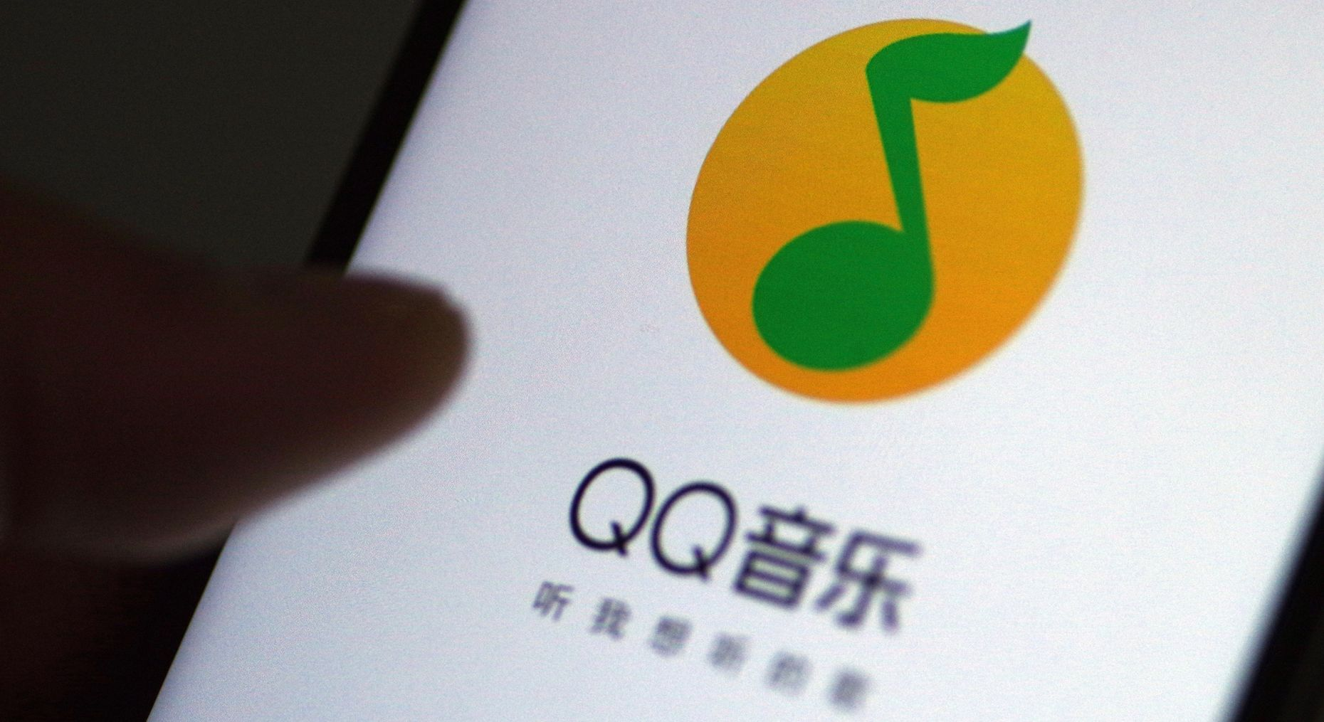 Tencent Music's QQ music streaming app on a phone in China last March. Photo by AP