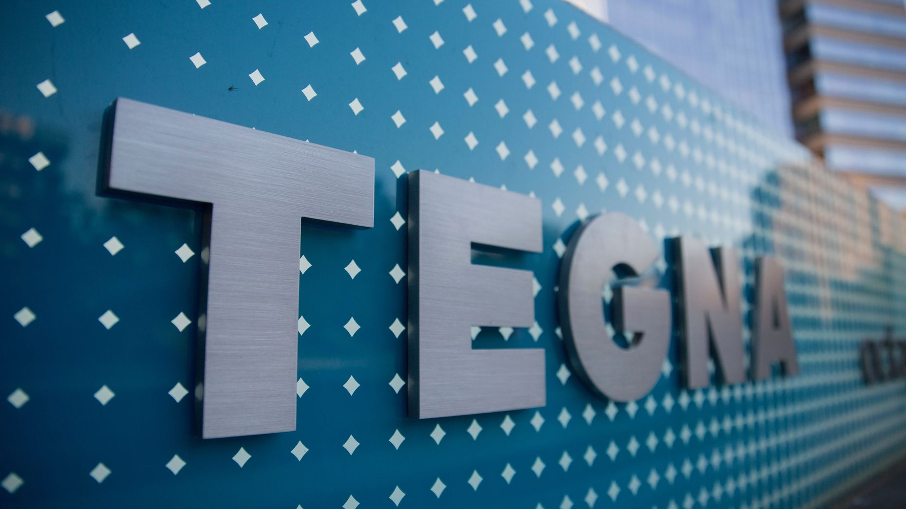 A Tegna sign at the company headquarters. Photo by Bloomberg
