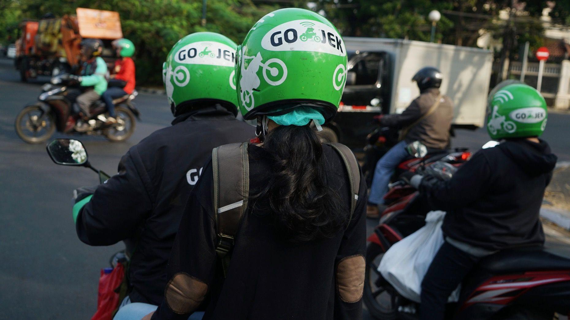 Go-Jek motorbike drivers and riders in Jakarta. Photo: Bloomberg