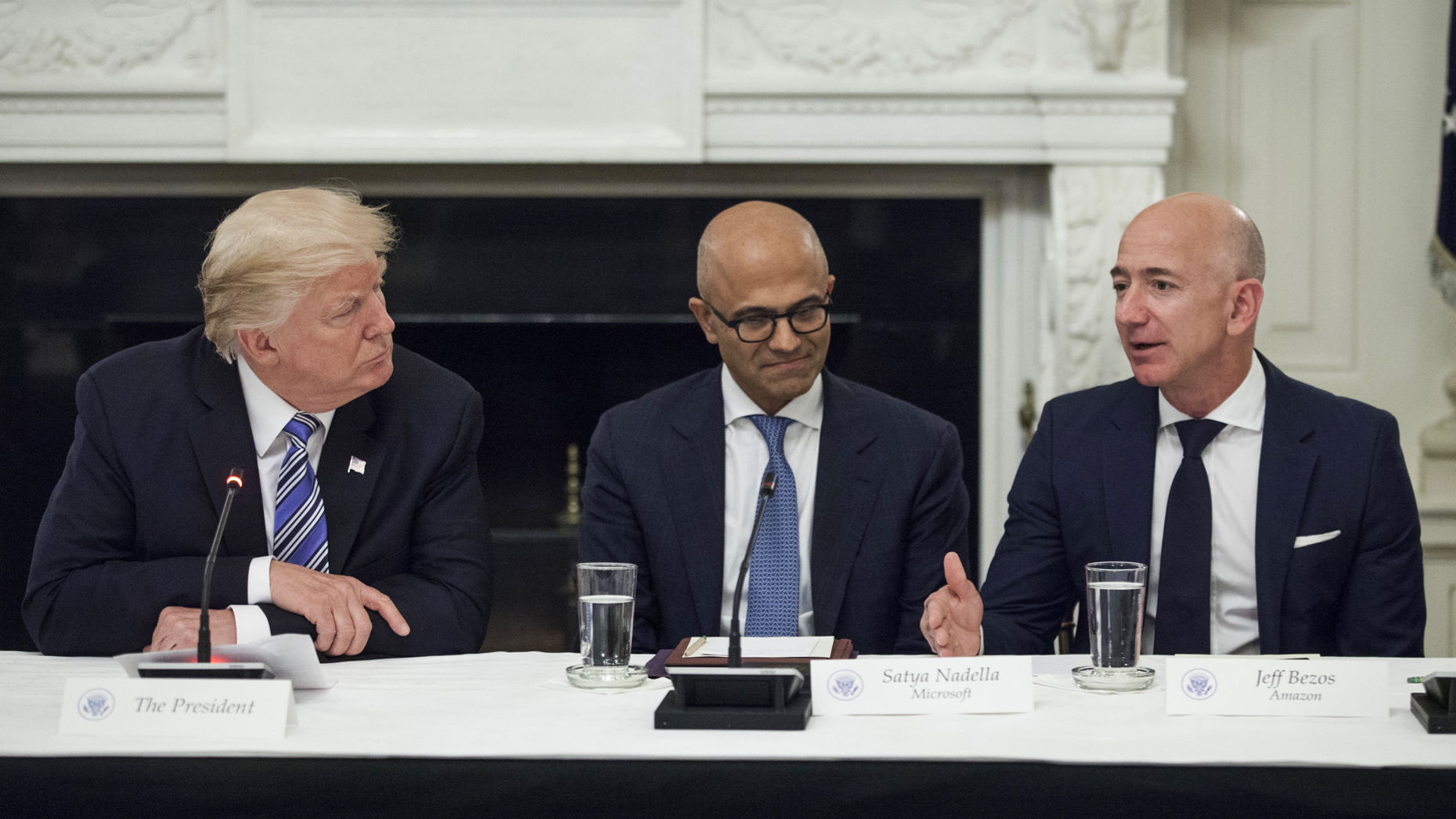 President Donald Trump, Microsoft CEO Satya Nadella and Amazon CEO Jeff Bezos at a White House event last year. Photo by Bloomberg