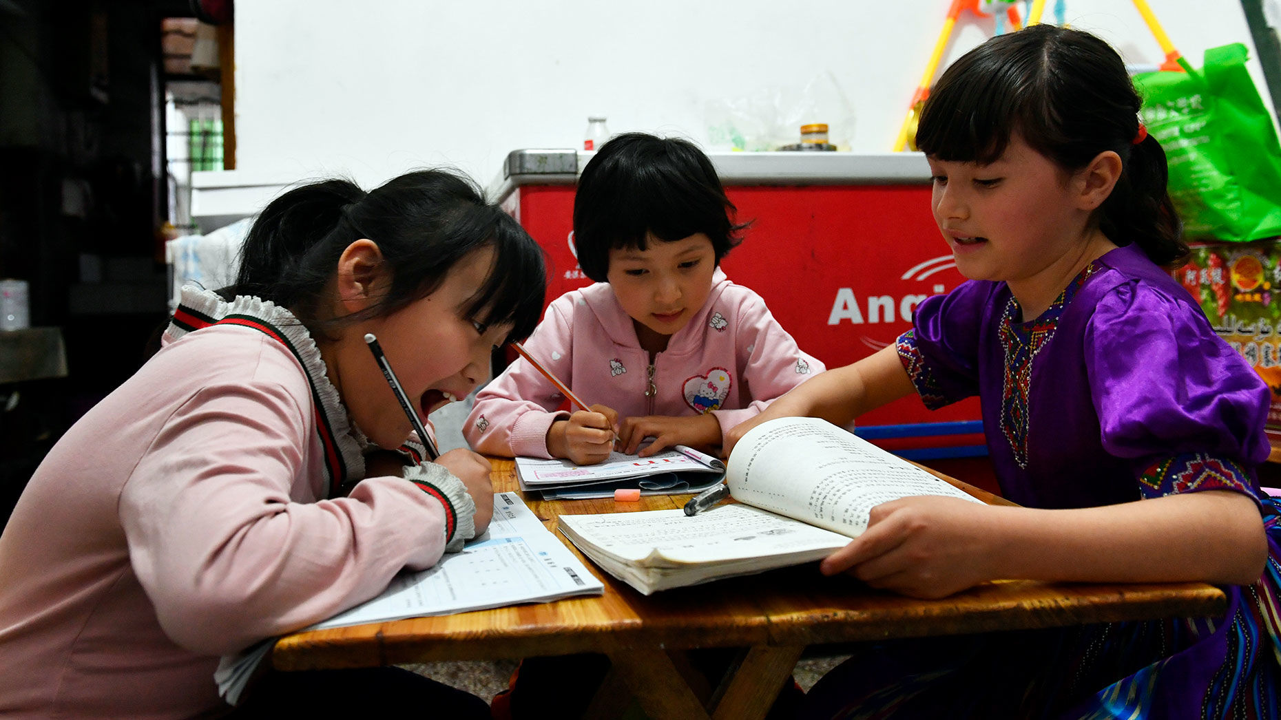 Primary school students in China doing homework 