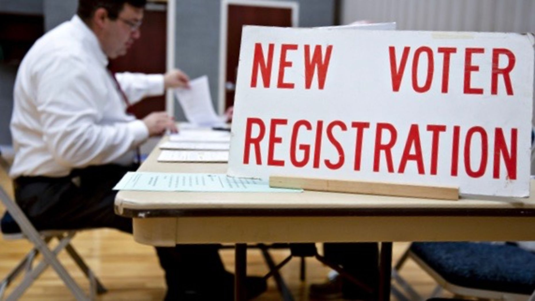 A voter registration table in Wisconsin in August. Photo by Bloomberg