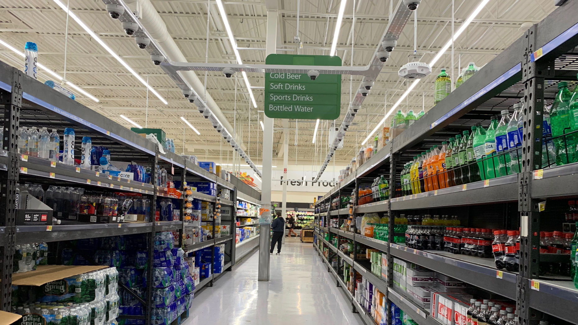 Cameras inside a Walmart store in Levittown, N.Y., where it is testing automation technologies. Photo by Jon Victor