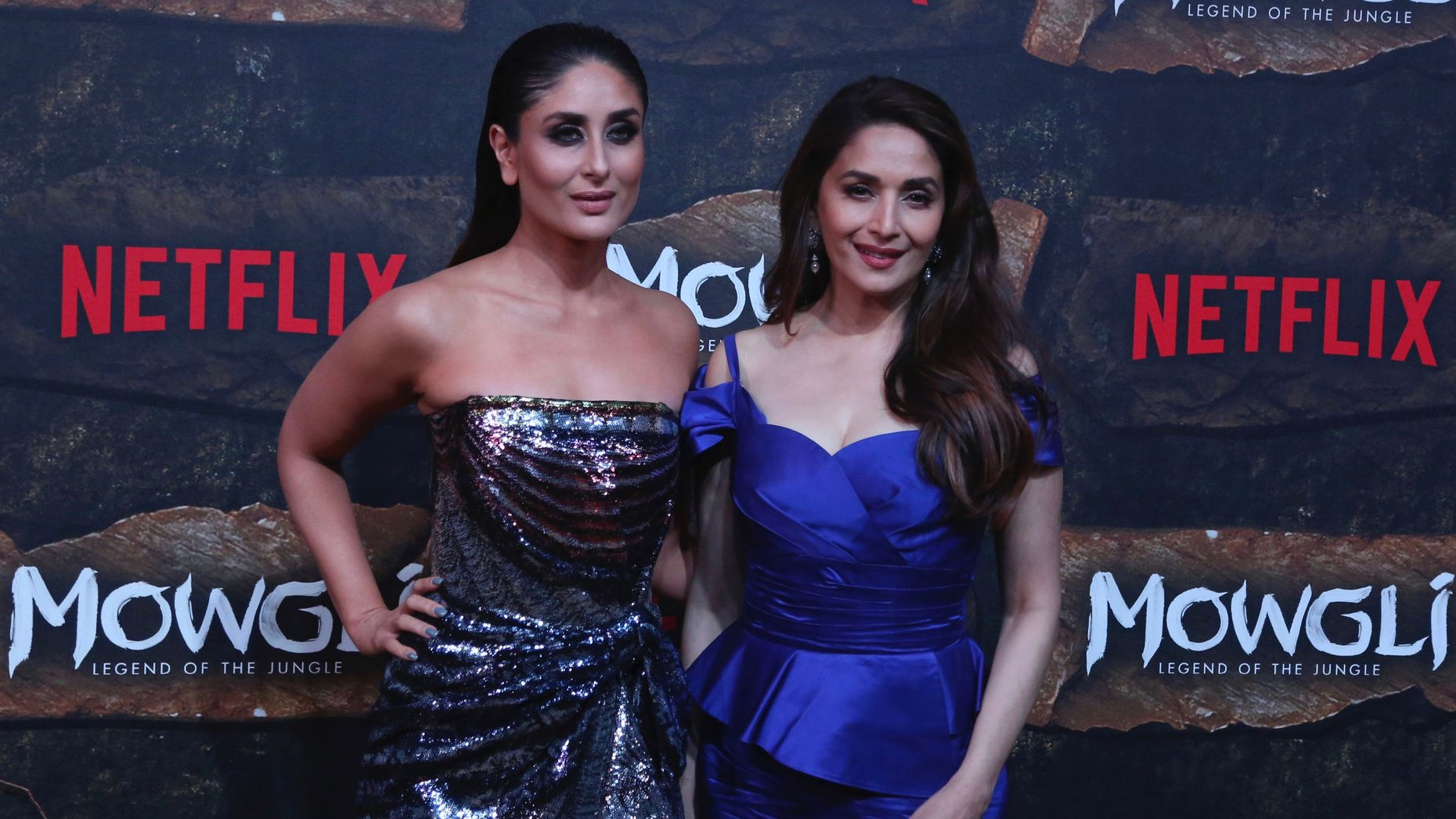 Bollywood actors Kareena Kapoor and Madhuri Dixit pose during a red carpet of Netflix's Mowgli world premier in Mumbai, India last Sunday. Photo by AP