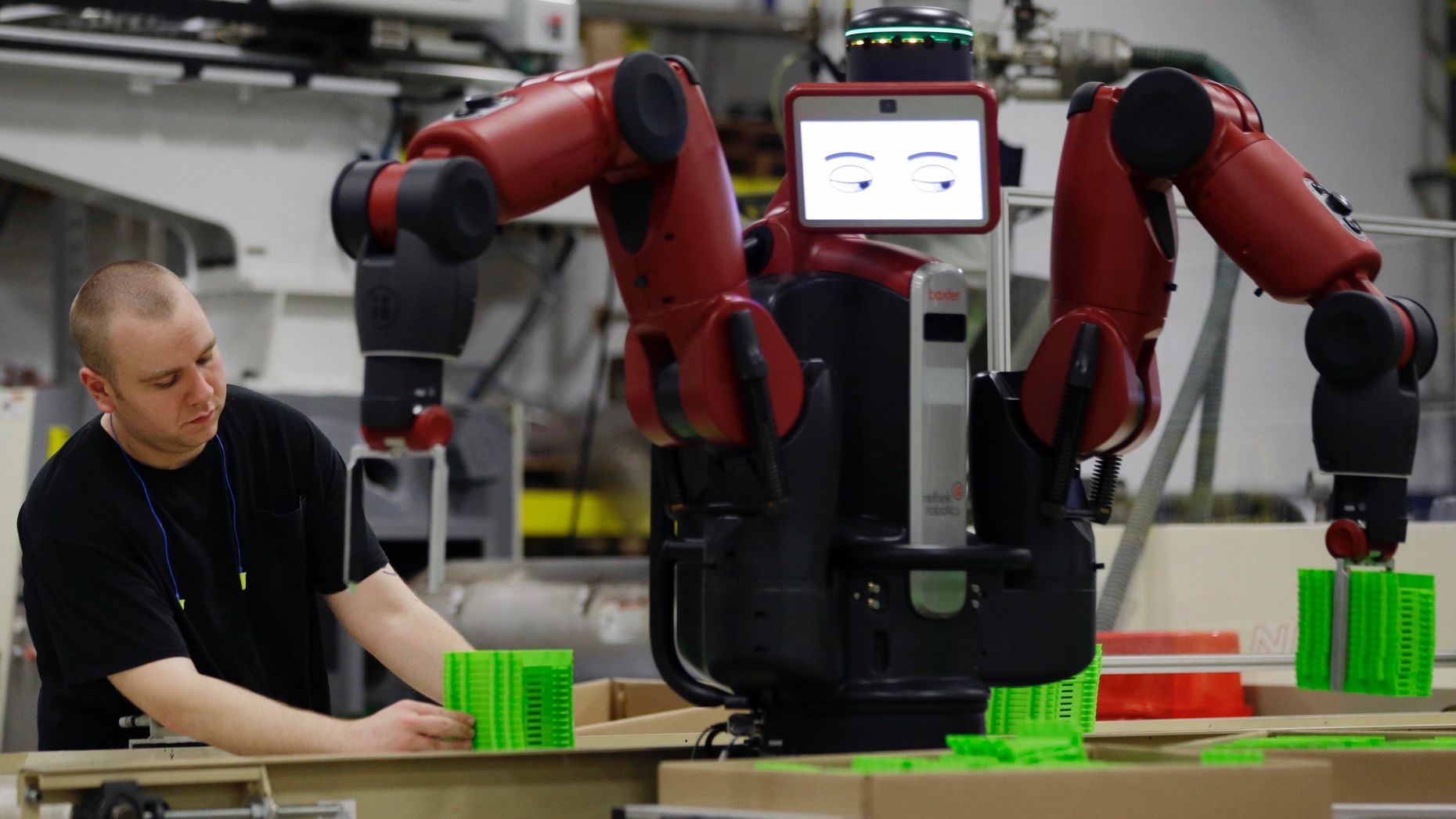 A technician works with Rethink's Baxter at The Rodon Group manufacturing facility in 2013. Photo by AP.