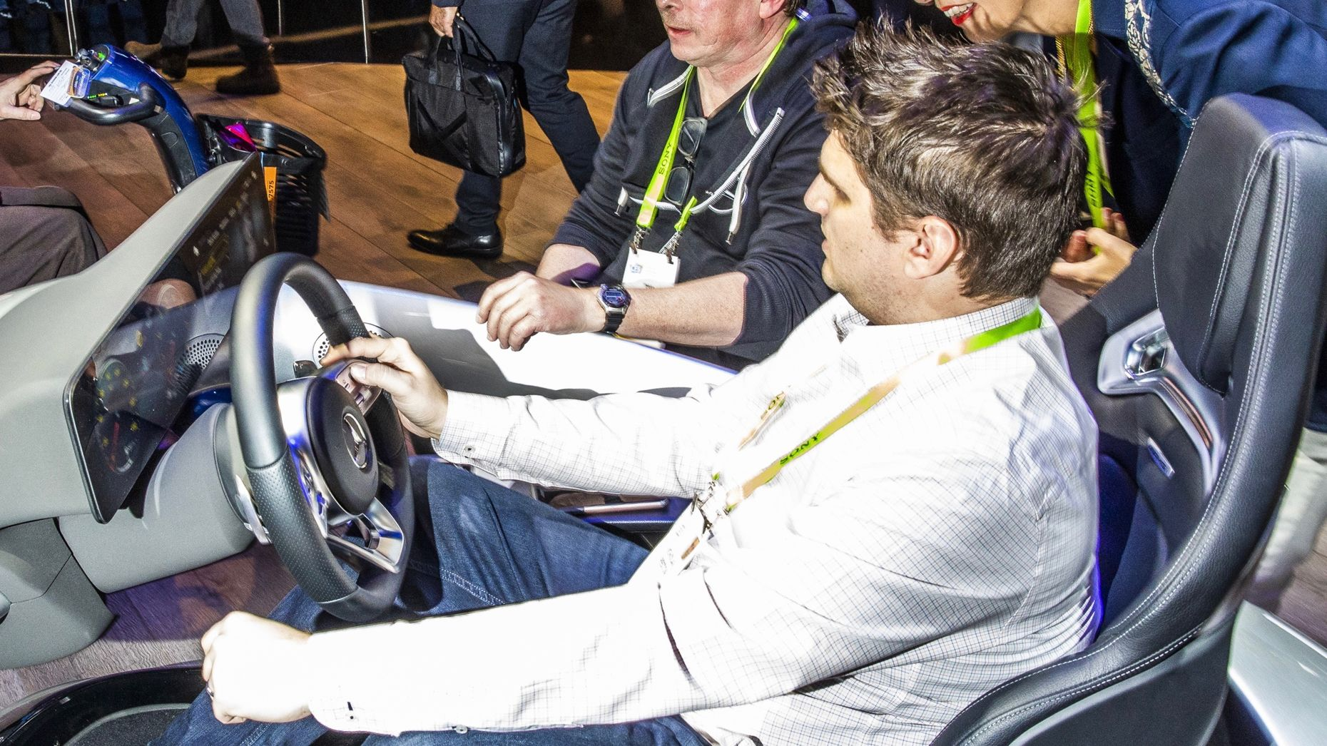 An attendee trying out the Mercedes Benz multimedia system at CES this week. Photo by Bloomberg