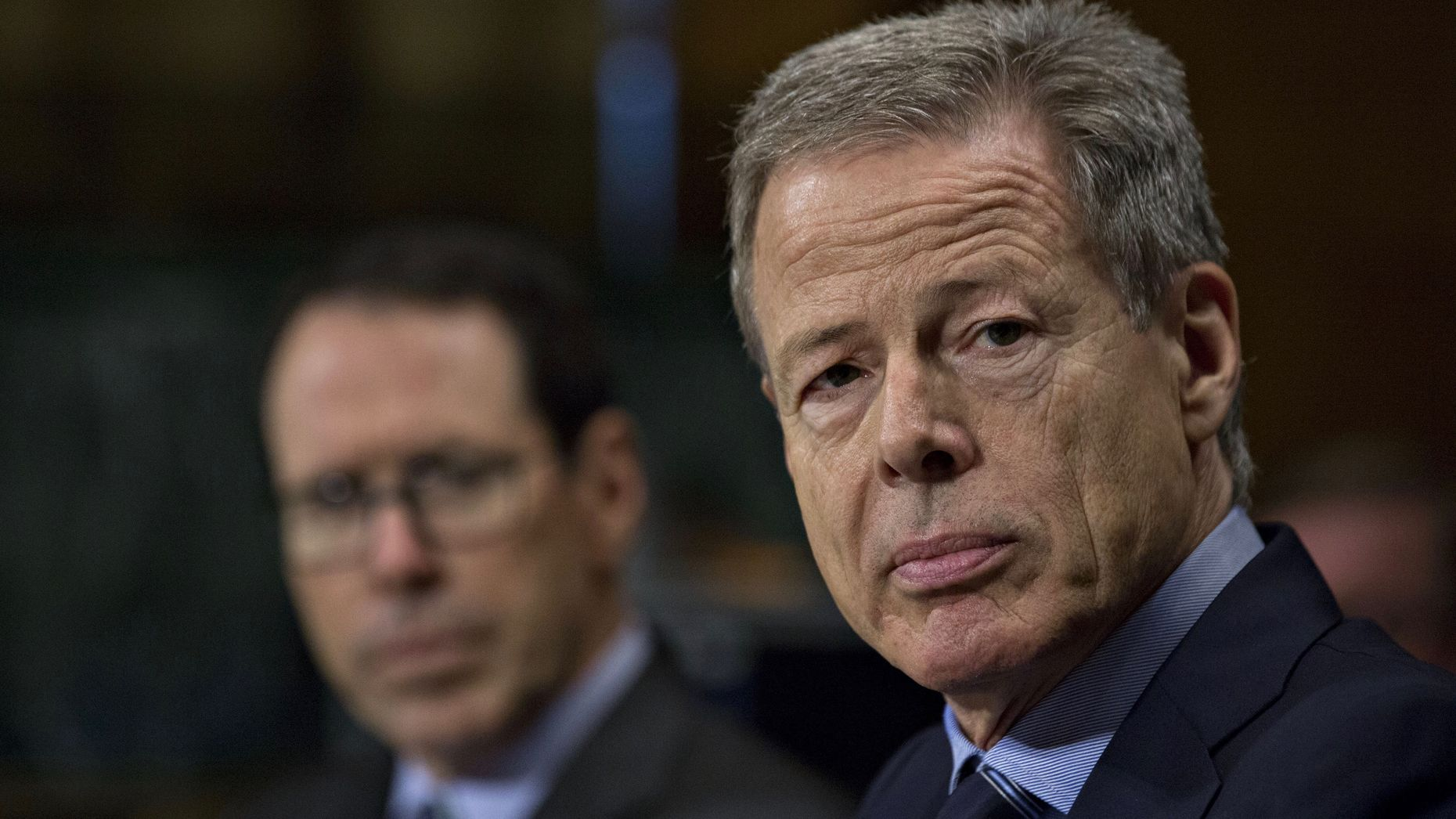 Time Warner's then CEO Jeff Bewkes, in the foreground, with AT&T CEO Randall Stephenson at a congressional hearing in December 2016. Photo by Bloomberg